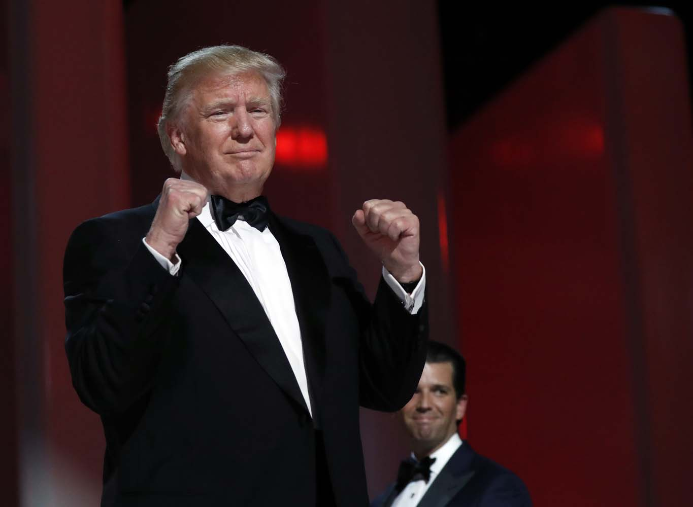 President Donald Trump acknowledges the crowd at the Liberty Ball, Friday, Jan. 20, 2017, in Washington. (AP Photo/Alex Brandon)