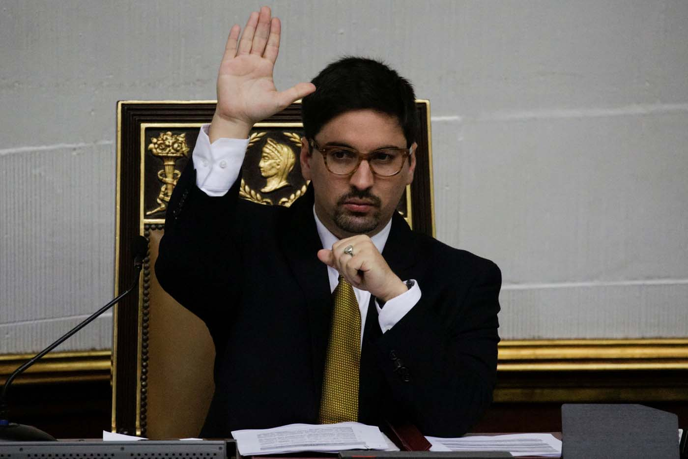 Freddy Guevara, first vice president of the National Assembly and deputy of the opposition party Popular Will (Voluntad Popular), raises his hand as he votes during a session of the National Assembly in Caracas, Venezuela January 17, 2017. Picture taken January 17, 2017. REUTERS/Marco Bello