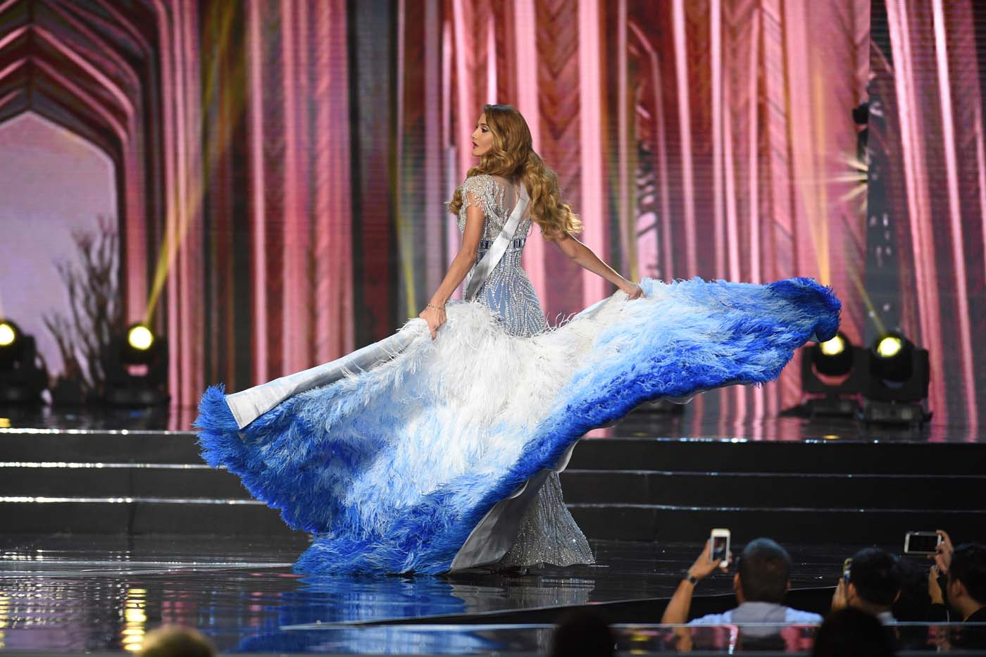 This photo taken on January 26, 2017 shows Miss Universe contestant Mariam Habach of Venezuela in her long gown during the preliminary competition of the Miss Universe pageant at the Mall of Asia arena in Manila. / AFP PHOTO / TED ALJIBE