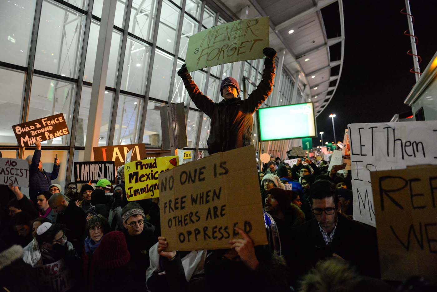 NEW YORK, NY - JANUARY 28: Protestors rally during a demonstration against the new immigration ban issued by President Donald Trump at John F. Kennedy International Airport on January 28, 2017 in New York City. President Trump signed the controversial executive order that halted refugees and residents from predominantly Muslim countries from entering the United States. Stephanie Keith/Getty Images/AFP