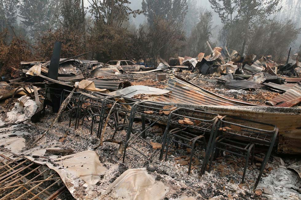 Remains of a burned down public school are seen, while wildfires ravaged wide swaths of the country's central-south regions, in town of Hualqui