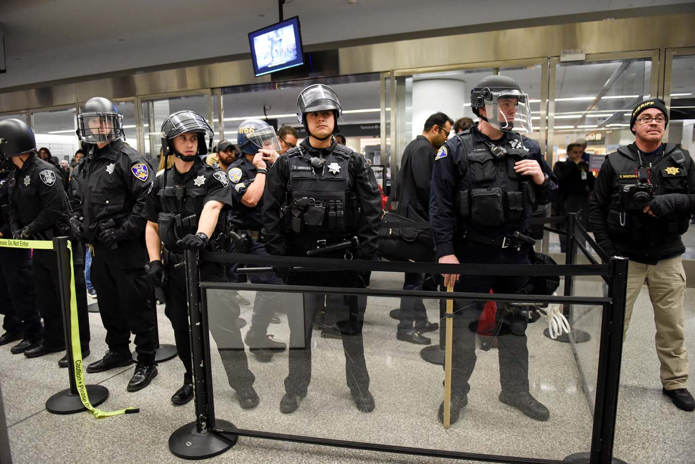 Police block a security check point inside Terminal 4 at San Francisco International Airport in San Francisco, California, U.S., January 28, 2017. REUTERS/Kate Munsch