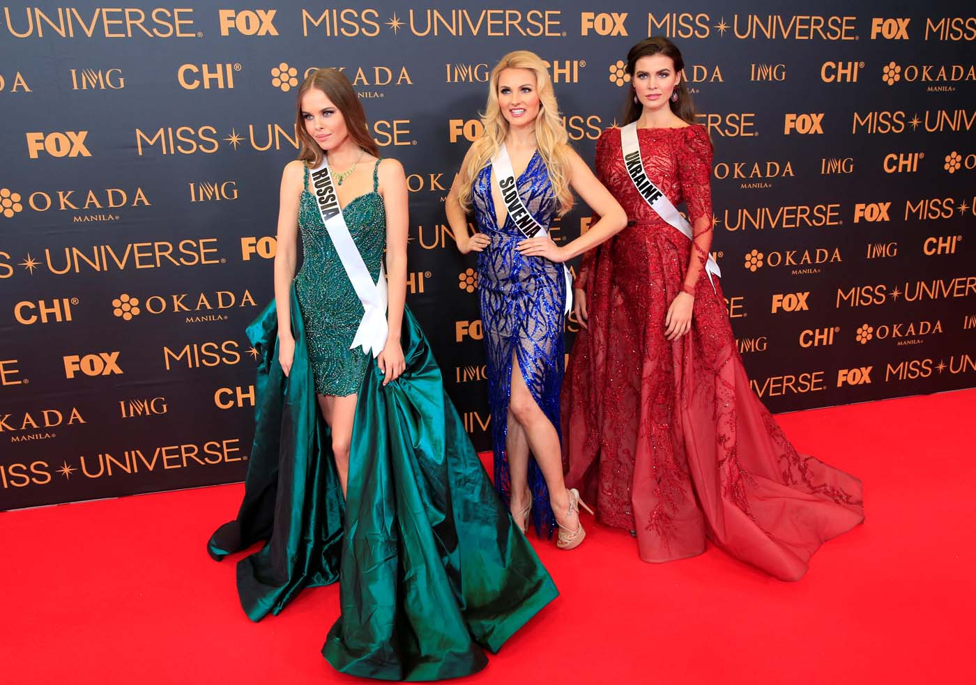 Miss Universe candidates - Miss Russia Yuliana Korolkova, Miss Slovenia Lucija Potocnik and Miss Ukraine Alena Spodynyuk pose for a picture during a red carpet inside a SMX convention in metro Manila, Philippines January 29, 2017. REUTERS/Romeo Ranoco