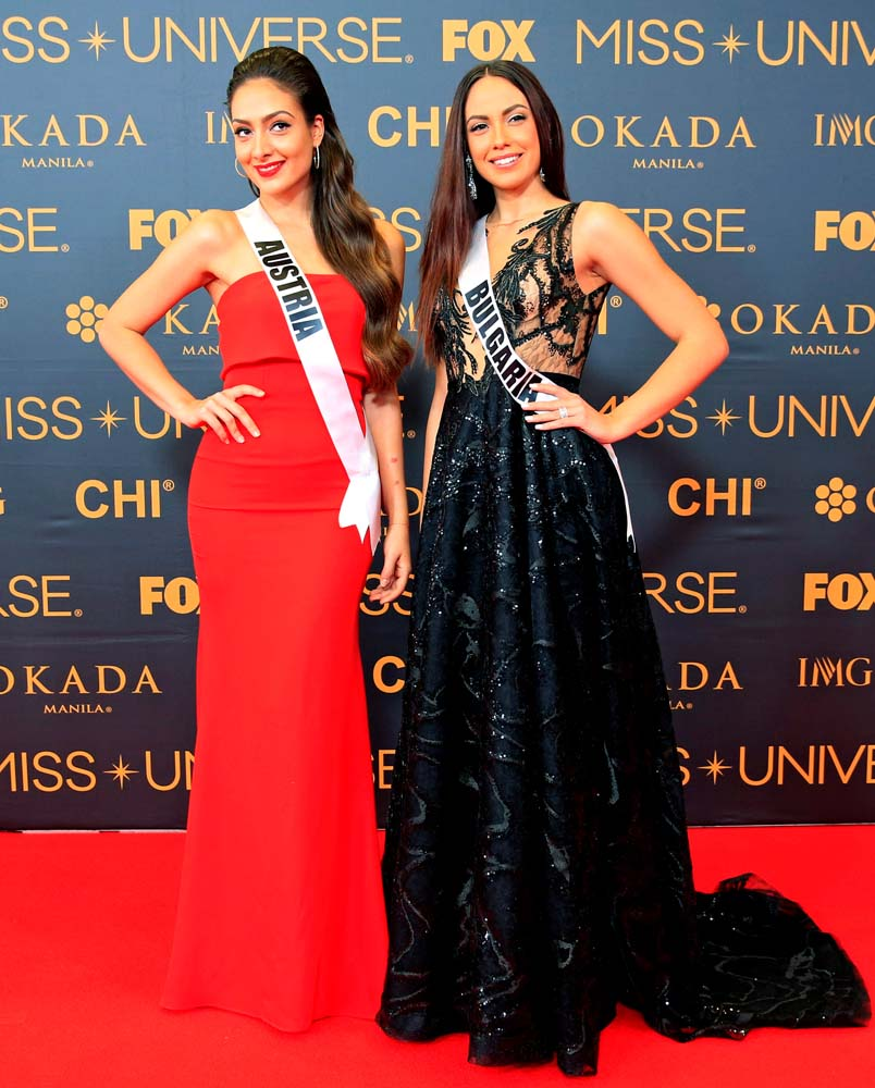 Miss Universe candidates Dajana Dzinic of Austria and Violina Ancheva of Bulgaria pose for a picture during a red carpet inside a SMX convention in metro Manila, Philippines January 29, 2017. REUTERS/Romeo Ranoco