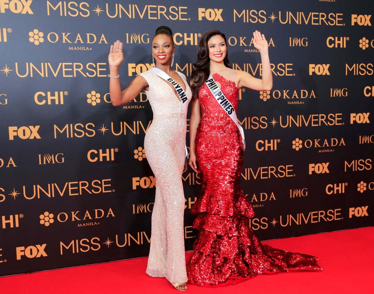 Miss Universe candidates Guyana Soyini Fraser of Guyana and Maxine Medinage of Philippines gesture for a picture during a red carpet inside a SMX convention in metro Manila, Philippines January 29, 2017. REUTERS/Romeo Ranoco