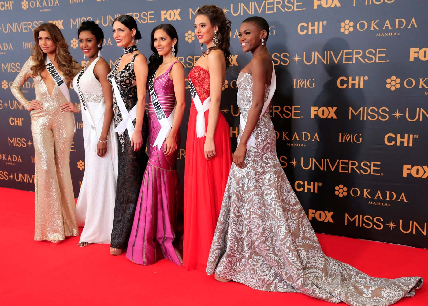 Miss Universe candidates pose for a picture during a red carpet inside a SMX convention in metro Manila, Philippines January 29, 2017. In Photo from L-R: Miss Panama Keity Drennan, Miss Cayman Islands Monyque Brooks, Miss Georgia Nuka Karalashvili, Miss U.S. Virgin Islands Carolyn Carter, Miss Netherlands Zoey Ivory and Miss Sierra Leone Hawa Kamara. REUTERS/Romeo Ranoco