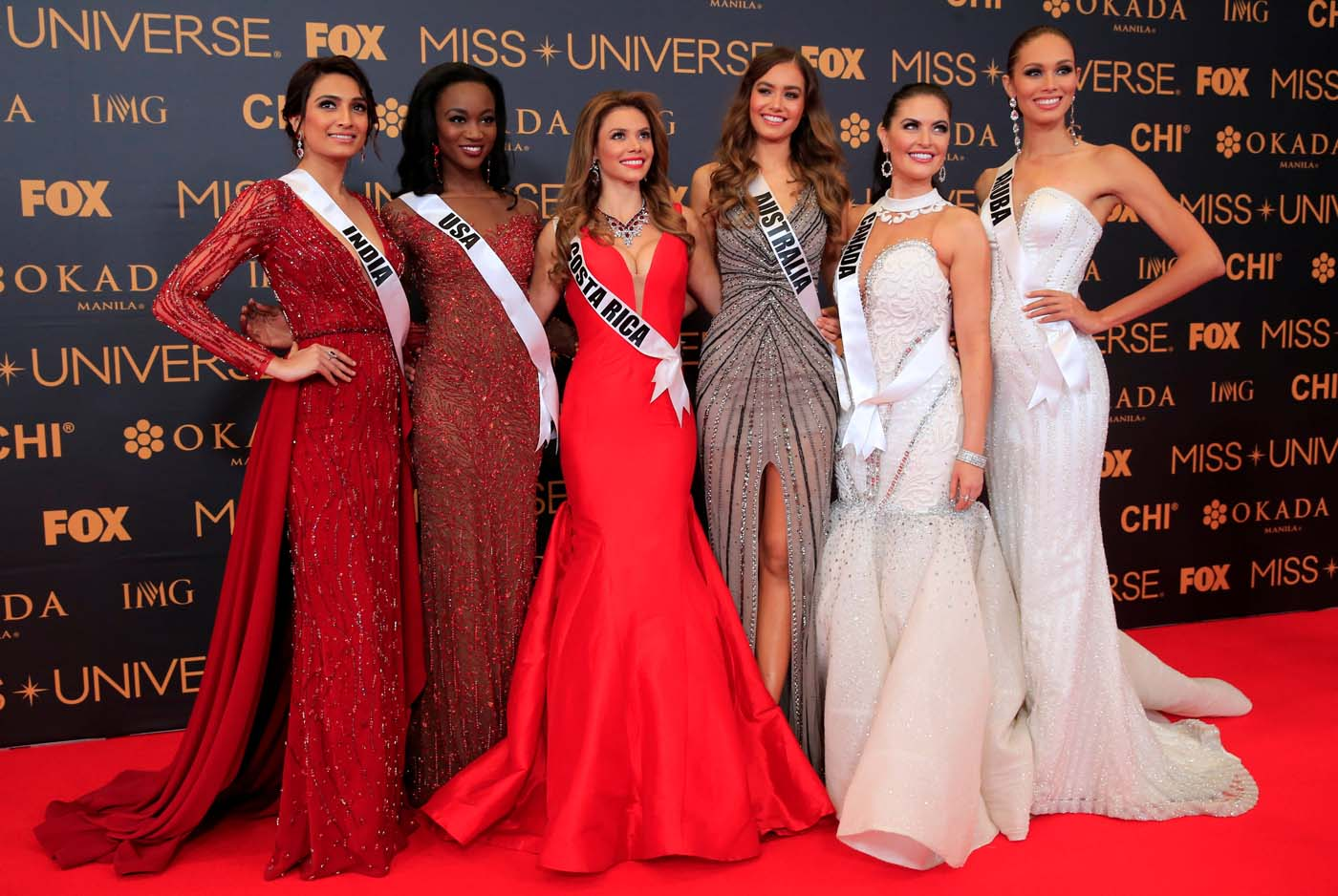 Miss Universe candidates pose for a picture during a red carpet inside a SMX convention in metro Manila, Philippines January 29, 2017. In Photo from L-R: Miss India Roshmitha Harimurthy, Miss USA Deshauna Barber, Miss Costa Rica Carolina Rodriguez, Miss Australia Caris Tiivel, Miss Canada Siera Bearchell and Miss Aruba Charlene Leslie. REUTERS/Romeo Ranoco
