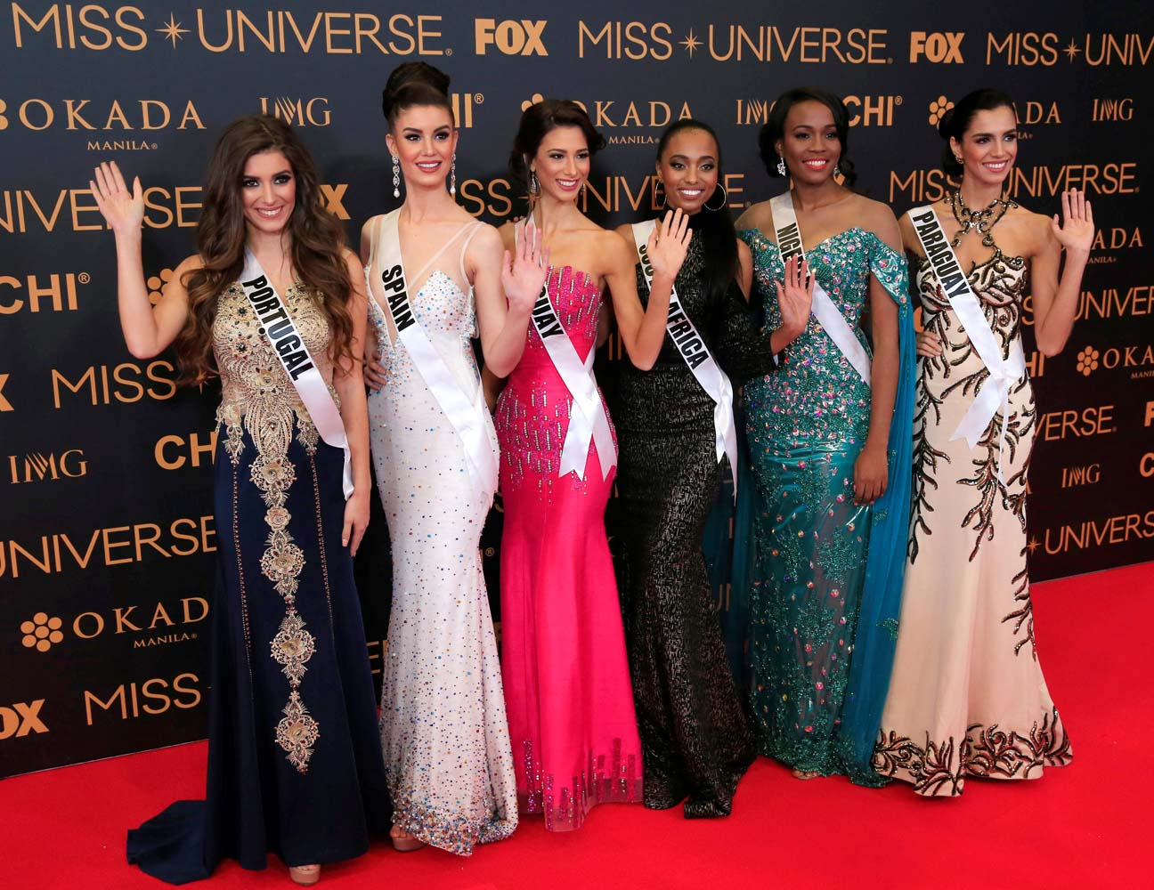 Miss Universe candidates gestures for a picture during a red carpet inside a SMX convention in metro Manila, Philippines January 29, 2017. In Photo from L-R: Miss Portugal Flavia Brito, Miss Spain Noelia Freire, Miss Uruguay Magdalena Cohendet, Miss South Africa Ntandoyenkosi Kunene, Miss Nigeria Unoaku Anyadike and Miss Paraguay Andrea Melgarejo. REUTERS/Romeo Ranoco