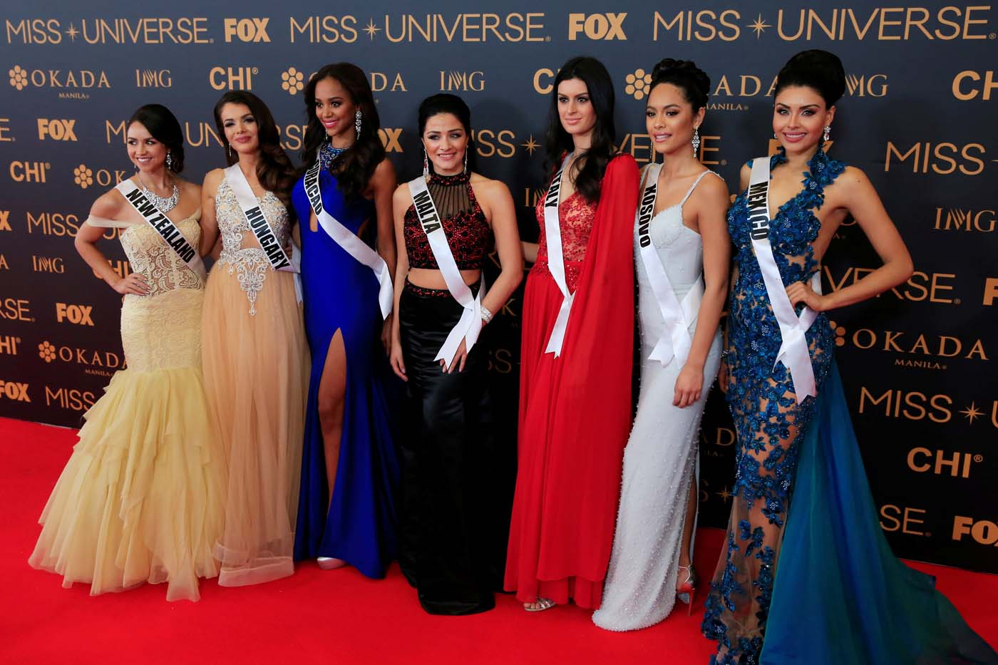 Miss Universe candidates pose for a picture during a red carpet inside a SMX convention in metro Manila, Philippines January 29, 2017. In Photo from L-R: Miss New Zealand Zoey Ivory, Miss Hungary Veronika Bodizs, Miss Curacao Chanelle de Lau, Miss Malta Martha Fenech, Miss Italy Sophia Sergio, Miss Kosovo Camila Barraza and Miss Mexico Kristal Silva. REUTERS/Romeo Ranoco