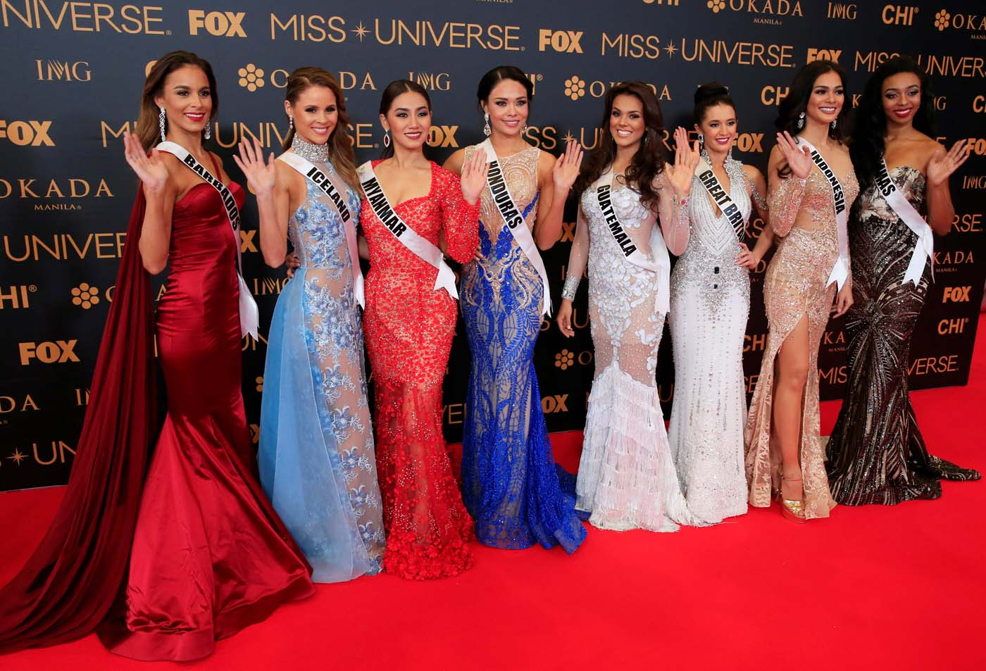 Miss Universe candidates gestures for a picture during a red carpet inside a SMX convention in metro Manila, Philippines January 29, 2017. In Photo from L-R: Miss Barbados Shannon Harris, Miss Iceland Hildur Maria Leifsdottir, Miss Myanmar Htet Htet Htun, Miss Honduras Sirey Moran, Miss Guatemala Virginia Argueta, Miss Great Britain Jaime-Lee Faulkner, Miss Indonesia Kezia Warouw and Miss Bahamas Cherell Williamson. REUTERS/Romeo Ranoco