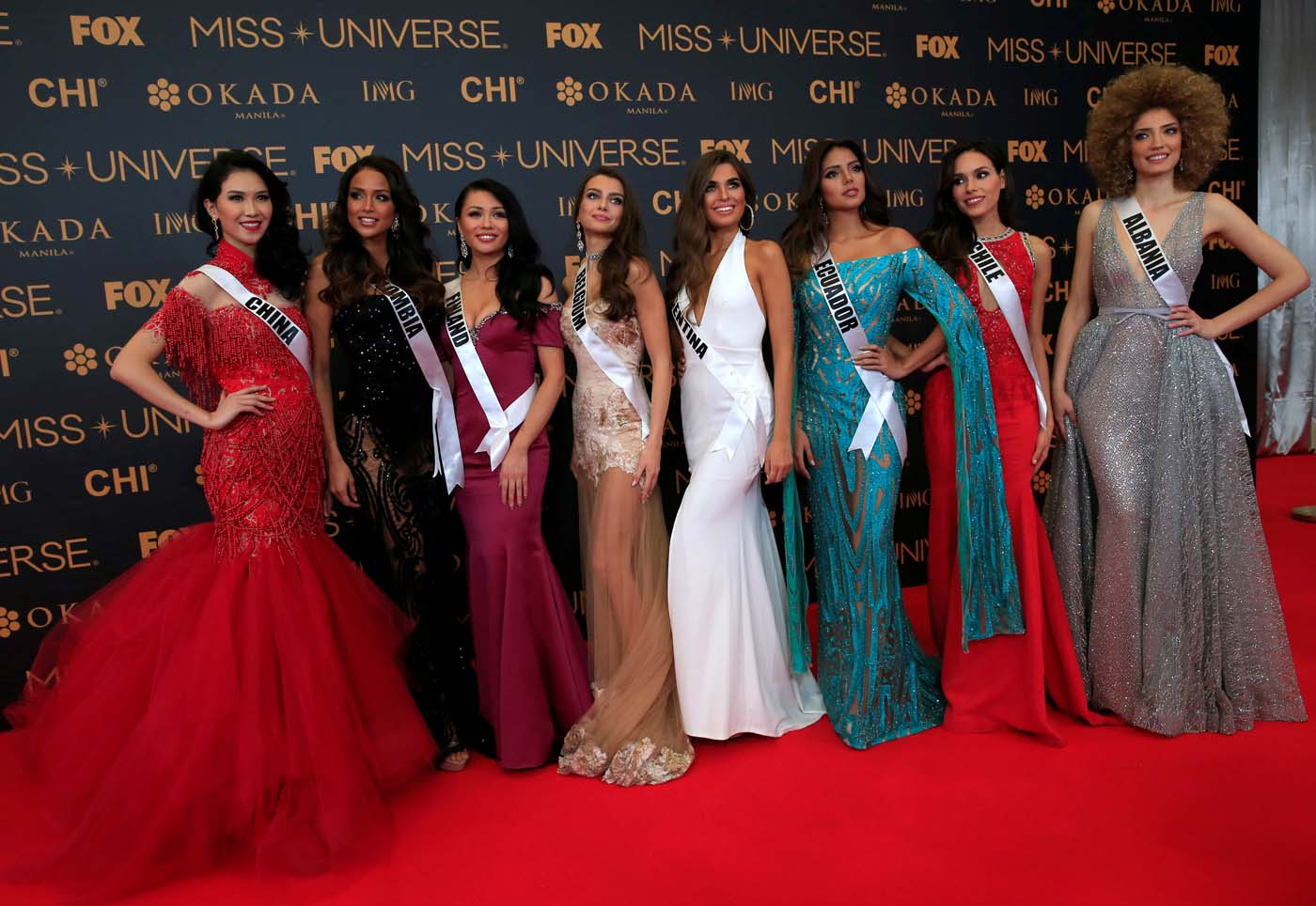 Miss Universe candidates pose for a picture during a red carpet inside a SMX convention in metro Manila, Philippines January 29, 2017. In Photo from L-R: Miss China Li Zhenying, Miss Colombia Andrea Tovar, Miss Finland Shirly Karvinen, Miss Belgium Stephanie Geldhof, Miss Argentina Estefania Bernal, Miss Ecuador Connie Jimenez and Miss Chile Catalina Caceres. REUTERS/Romeo Ranoco