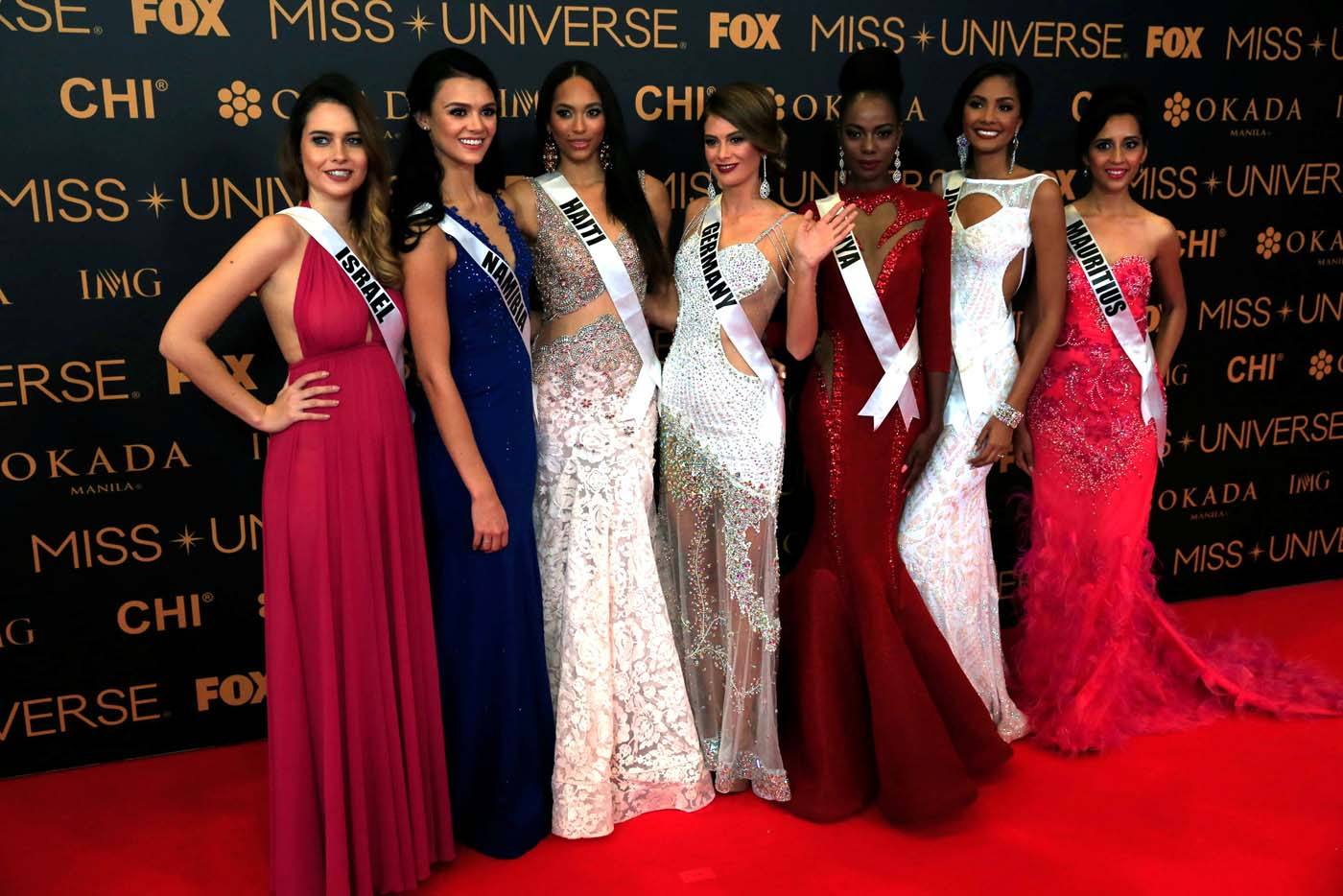 Miss Universe candidates pose for a picture during a red carpet inside a SMX convention in metro Manila, Philippines January 29, 2017. In Photo from L-R: Miss Israel Yam Kaspers Anshel, Miss Namibia Lizelle Esterhuizen, Miss Haiti Raquel Pelissier, Miss Germany Johanna Acs, Miss Kenya Mary Esther Were, Miss Jamaica Isabel Dalley and Miss Mauritius Kushboo Ramnawaj. REUTERS/Romeo Ranoco