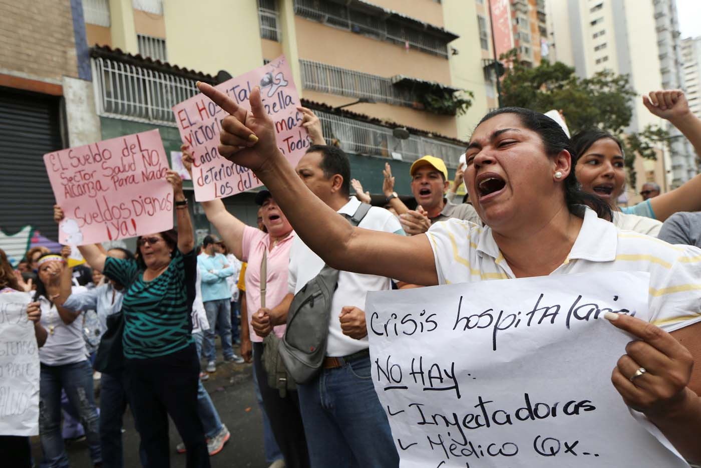 "Workers of the health sector and opposition supporters take part in a rally due to the shortages of basic medical supplies and against Venezuelan President Nicolas Maduro's government in Caracas, Venezuela February 7, 2017. The placard reads, ""Hospital crisis. There are not syringes. Doctors"". REUTERS/Carlos Garcia Rawlins"