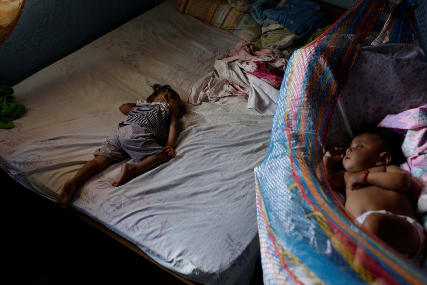 Sisters of Eliannys Vivas, who died from diphtheria, sleep in a room at their home in Pariaguan, Venezuela January 26, 2017. Picture taken January 26, 2017. REUTERS/Marco Bello