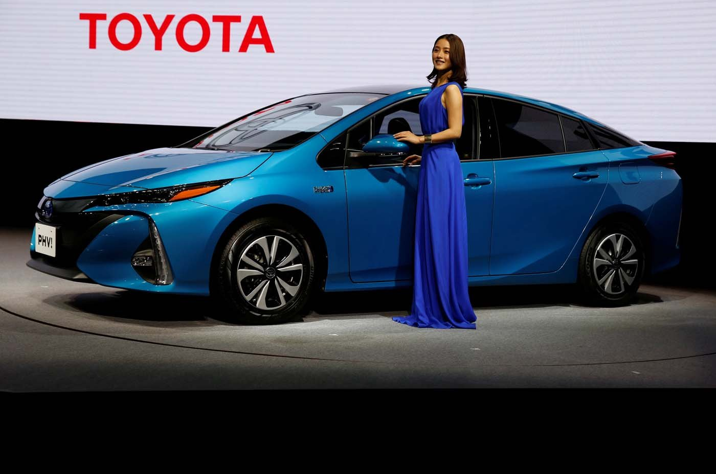 Japanese actress Satomi Ishihara poses next to Toyota Motor Corp.' Prius PHV Plug-in-Hybrid vehicle, also known as Prius Prime in the U.S., during an event to mark the launch of the car in Japan, in Tokyo, Japan February 15, 2017. REUTERS/Issei Kato