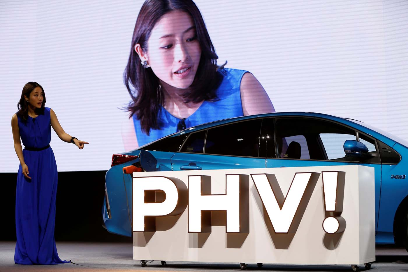 Japanese actress Satomi Ishihara demonstrates electric power supply system from Toyota Motor Corp.' Prius PHV Plug-in-Hybrid vehicle, also known as Prius Prime in the U.S., during an event to mark the launch of the car in Japan, in Tokyo, Japan February 15, 2017. REUTERS/Issei Kato