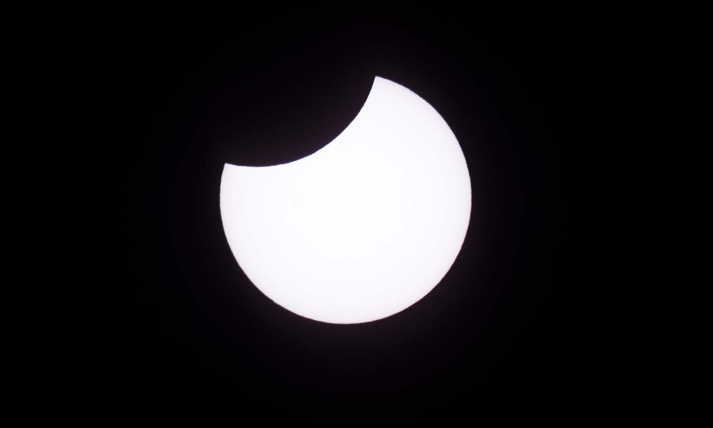 """Picture taken on February 26, 2017 showing the moon moving to cover the sun for an annular solar eclipse, as seen from the Estancia El Muster, near Sarmiento, Chubut province, 1600 km south of Buenos Aires, Argentina, on February 26, 2017. Stargazers applauded as they were plunged into darkness Sunday when the moon passed in front of the sun in a spectacular """"ring of fire"""" eclipse. / AFP PHOTO / ALEJANDRO PAGNI"""