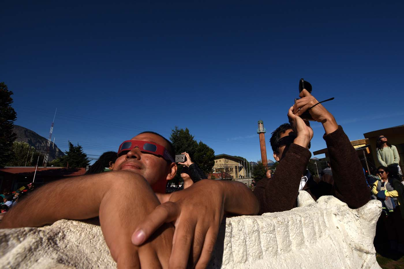People observe a solar eclipse in Coyhaique, Chile February 26, 2017. REUTERS/Stringer EDITORIAL USE ONLY. NO RESALES. NO ARCHIVE