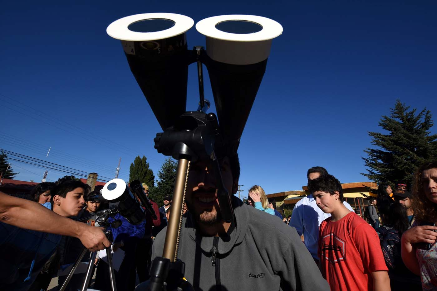A man observes a solar eclipse in Coyhaique, Chile February 26, 2017. REUTERS/Stringer EDITORIAL USE ONLY. NO RESALES. NO ARCHIVE