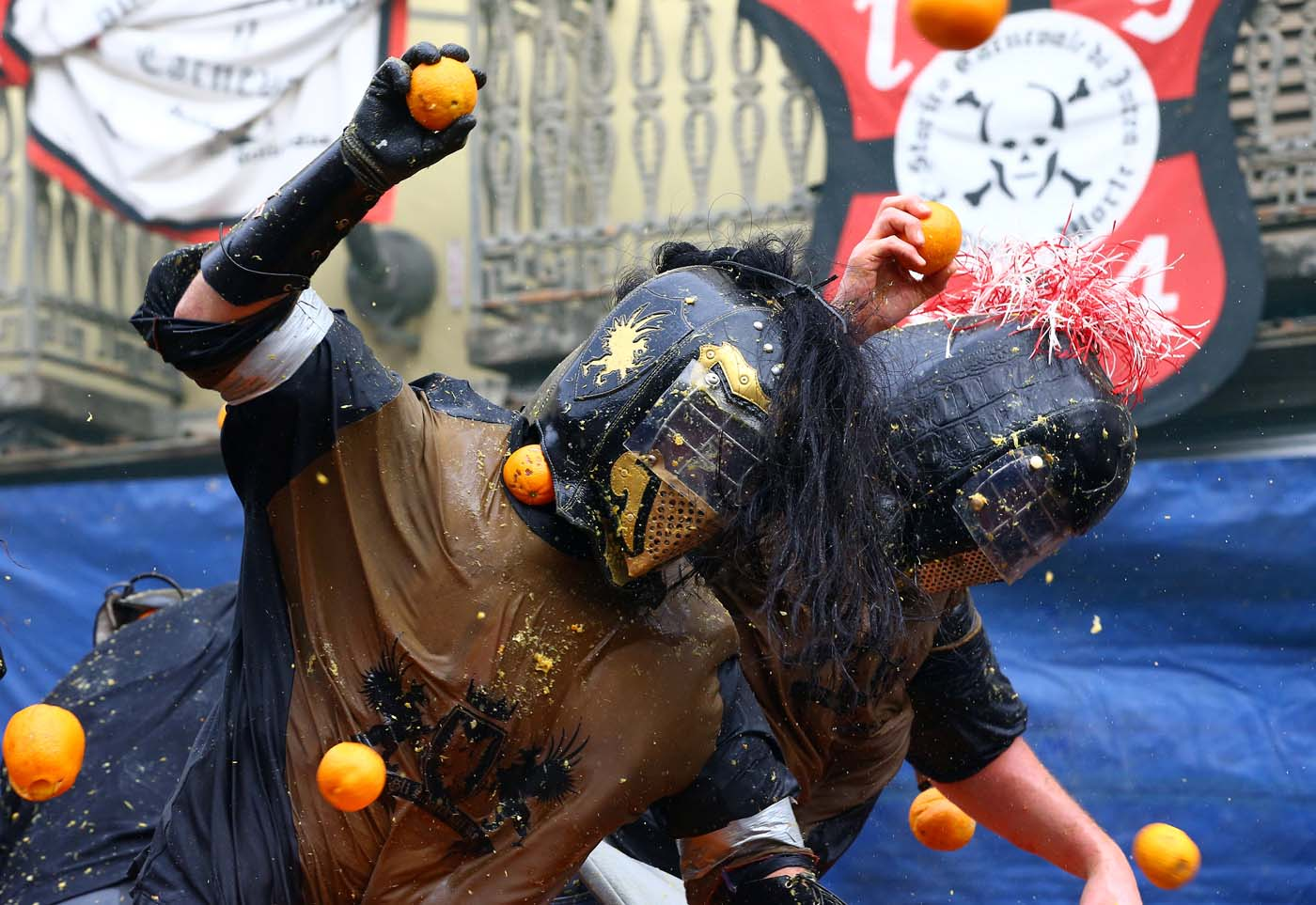 Members of a rival team are hit by oranges during an annual carnival orange battle in the northern Italian town of Ivrea February 26, 2017. REUTERS/Stefano Rellandini