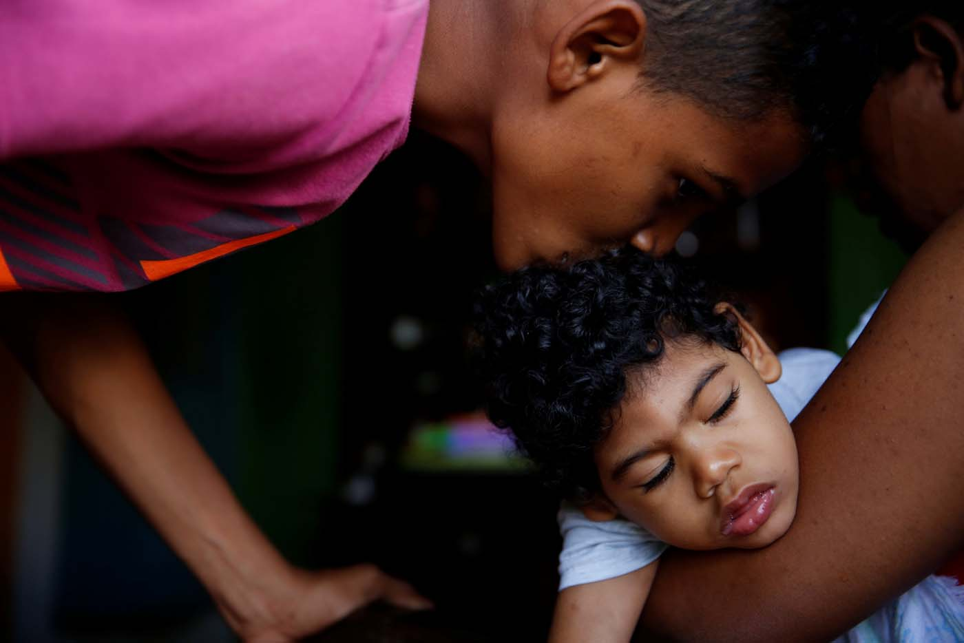 "Isai Rocha (L), 14, kisses his brother Kaleth Heredia, 2, neurological patient being treated with anticonvulsants, before going out, at their house in Caracas, Venezuela January 31, 2017. REUTERS/Carlos Garcia Rawlins    SEARCH ""EPILEPSY CARACAS"" FOR THIS STORY. SEARCH ""WIDER IMAGE"" FOR ALL STORIES."