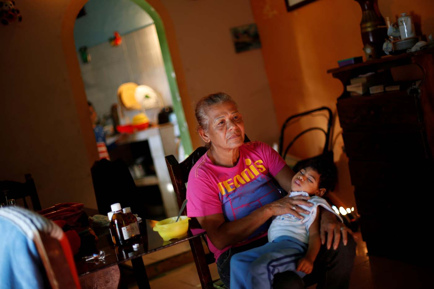 "Isabel Buelvas takes a break while she gives a meal to her grandson Kaleth Heredia, 2, a neurological patient being treated with anticonvulsants, at their house in Caracas, Venezuela January 30, 2017. REUTERS/Carlos Garcia Rawlins   SEARCH ""EPILEPSY CARACAS"" FOR THIS STORY. SEARCH ""WIDER IMAGE"" FOR ALL STORIES."