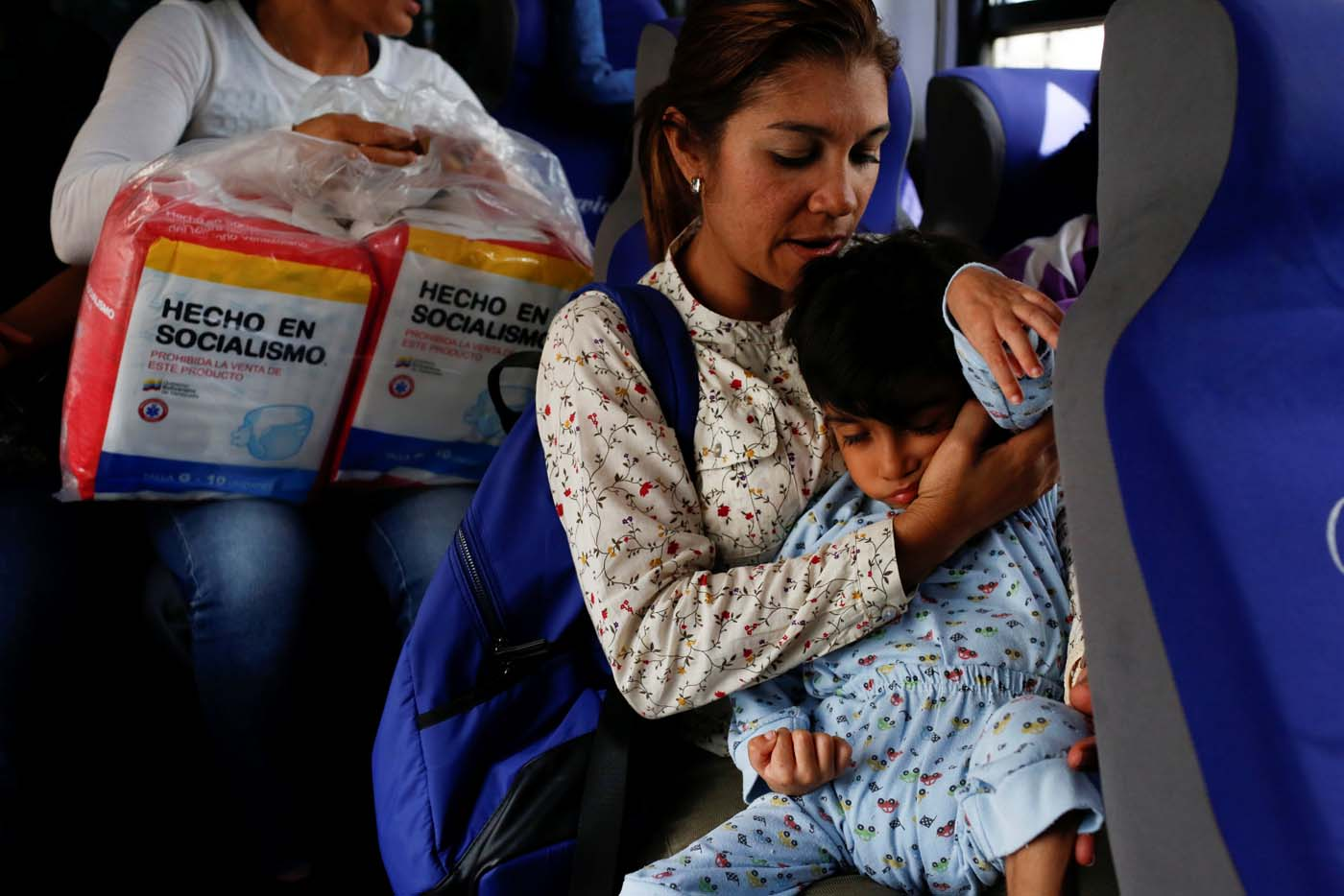 "Norymar Torres carries her son Leonardo Colmenares, 6, neurological patient being treated with anticonvulsants, while they travel on public transport in Caracas, Venezuela January 18, 2017. REUTERS/Carlos Garcia Rawlins   SEARCH ""EPILEPSY CARACAS"" FOR THIS STORY. SEARCH ""WIDER IMAGE"" FOR ALL STORIES."