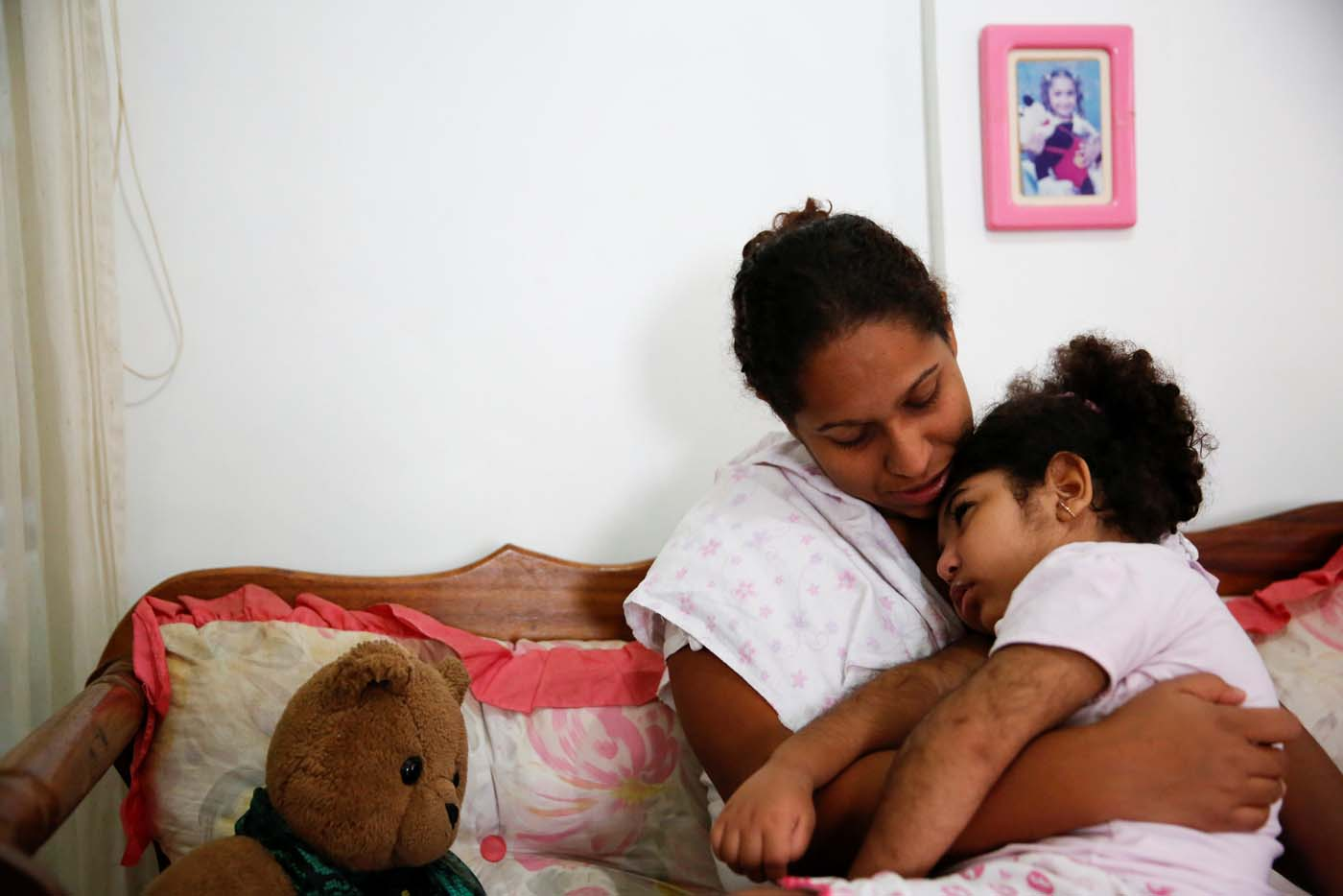 "Lusnay Echezuria, embraces her daughter Arioska Torres, 3, a neurological patient being treated with anticonvulsants, at their house in Caracas, Venezuela January 30, 2017. REUTERS/Carlos Garcia Rawlins   SEARCH ""EPILEPSY CARACAS"" FOR THIS STORY. SEARCH ""WIDER IMAGE"" FOR ALL STORIES."