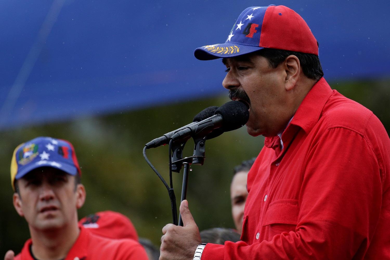 Venezuela's President Nicolas Maduro speaks during a pro-government rally next to Venezuela's Vice President Tareck El Aissami in Caracas Venezuela