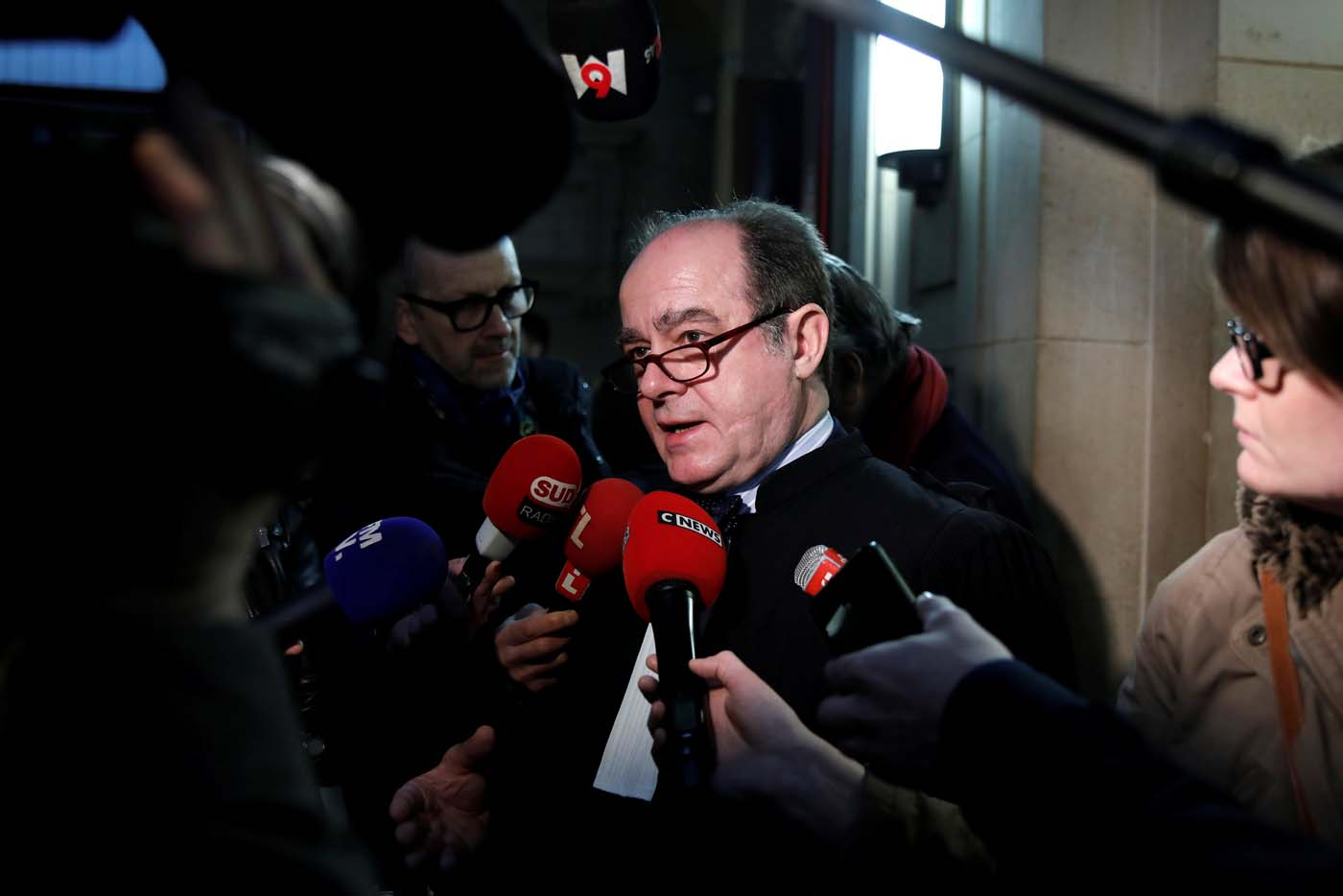 "Georges Holleaux, a lawyer representing the two widows of the men killed and 16 other people affected, talks to journalists before the opening of the trial of Ilich Ramirez Sanchez, known as ""Carlos the Jackal"", at the courthouse in Paris, France March 13, 2017. Carlos the Jackal is appearing in a Paris court for a deadly 1974 attack at a shopping arcade in the French capital, a trial that victims' families have been awaiting for decades. REUTERS/Benoit Tessier"
