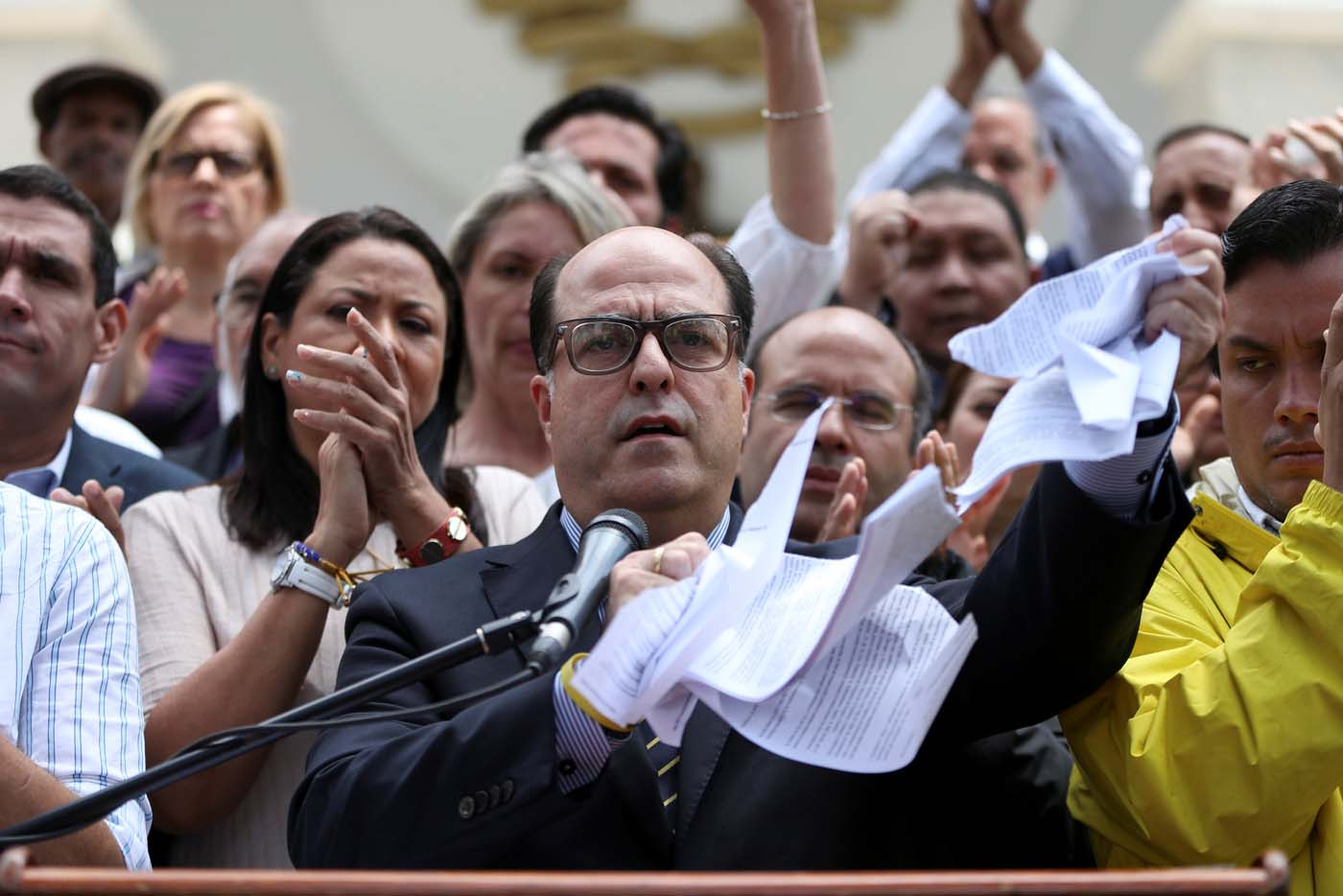 Julio Borges (C), President of the National Assembly and deputy of the Venezuelan coalition of opposition parties (MUD), tears a copy of a sentence of the Venezuela's Supreme Court during a news conference in Caracas, Venezuela March 30, 2017. REUTERS/Carlos Garcia Rawlins