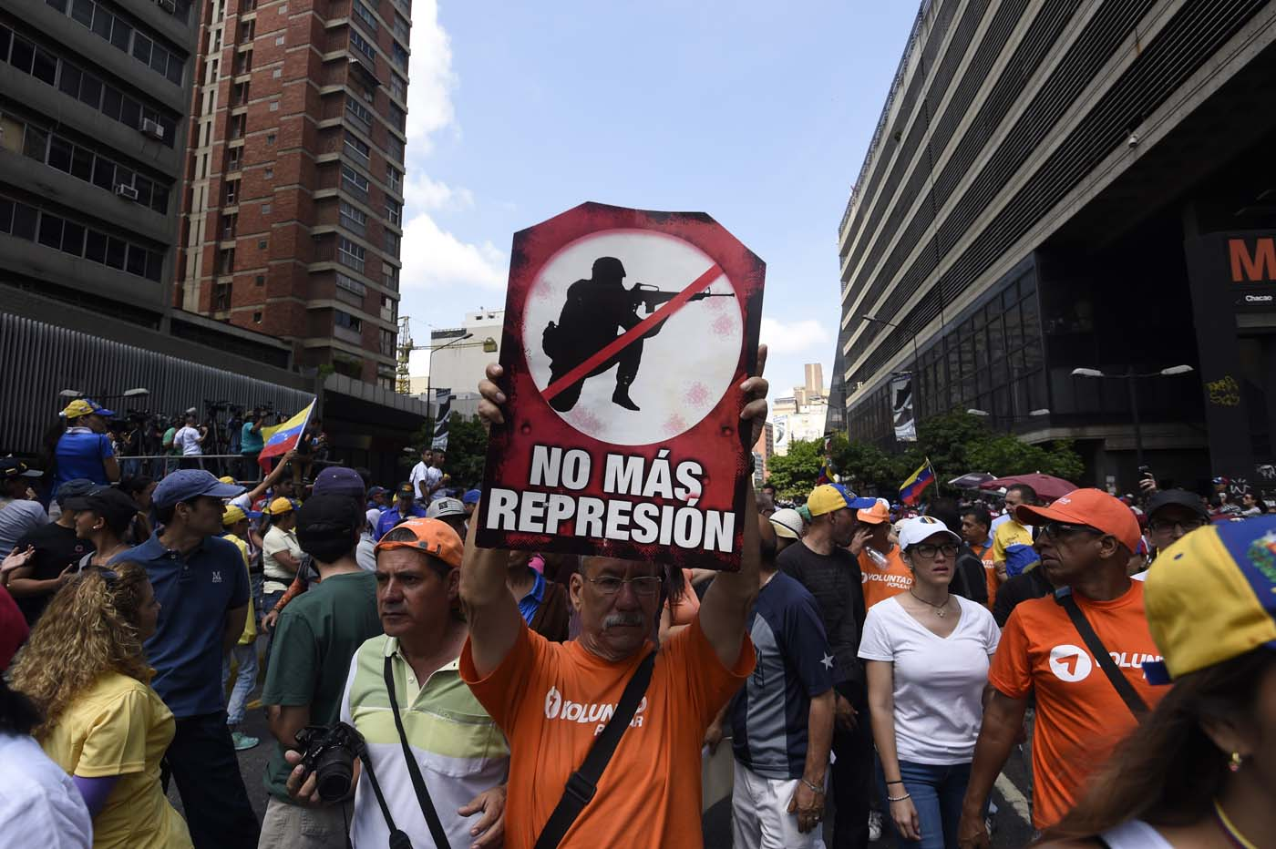 Demonstrators against Nicolas Maduro's government gather at Chacao municipality, east of Caracas on April 8, 2017. The opposition is accusing pro-Maduro Supreme Court judges of attempting an internal