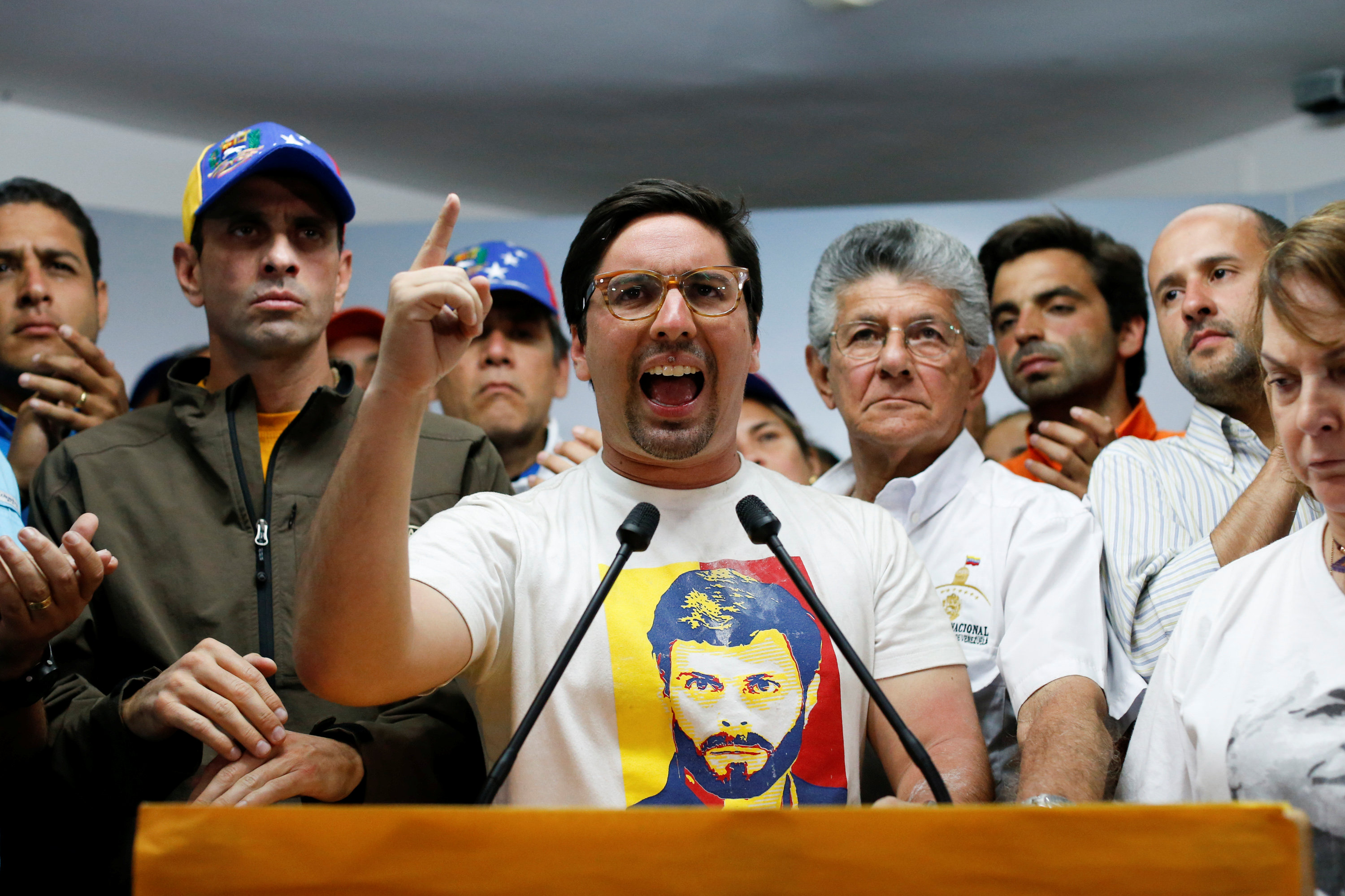 Freddy Guevara (C), First Vice President of the National Assembly and deputy of the opposition party Popular Will (Voluntad Popular), speaks during a news conference in Caracas, Venezuela, April 6, 2017. REUTERS/Carlos Garcia Rawlins