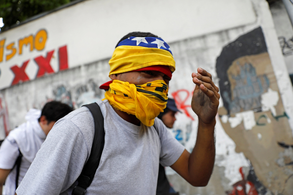 A demonstrator reacts as the riot police clashes with opposition supporters during a rally in Caracas, Venezuela, April 8, 2017. REUTERS/Carlos Garcia Rawlins