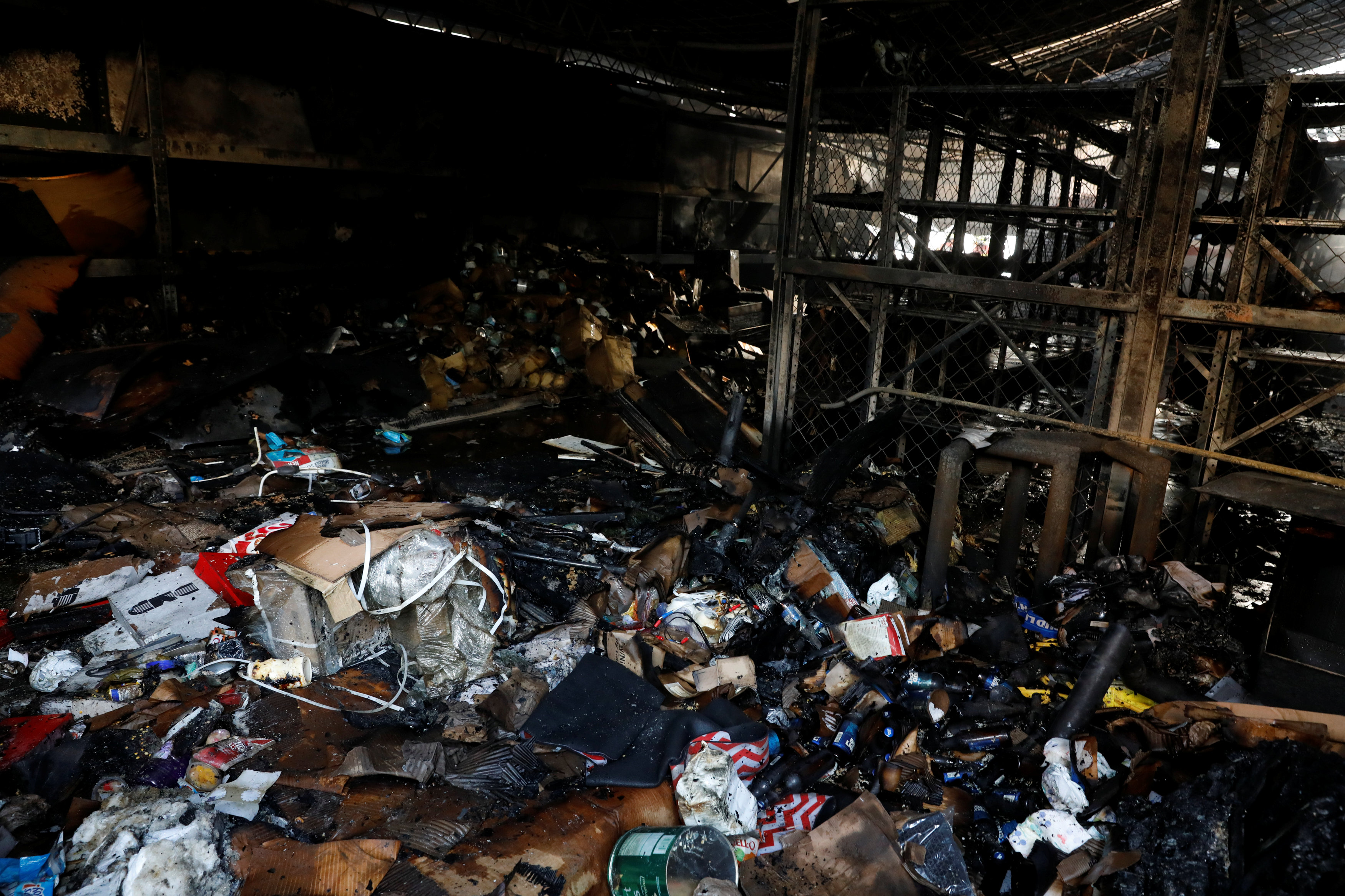 Burned debris are seen in a warehouse in the building where the offices of Venezuelan opposition leader and Governor of Miranda state Henrique Capriles are located, in Caracas, Venezuela, April 8, 2017. REUTERS/Carlos Garcia Rawlins