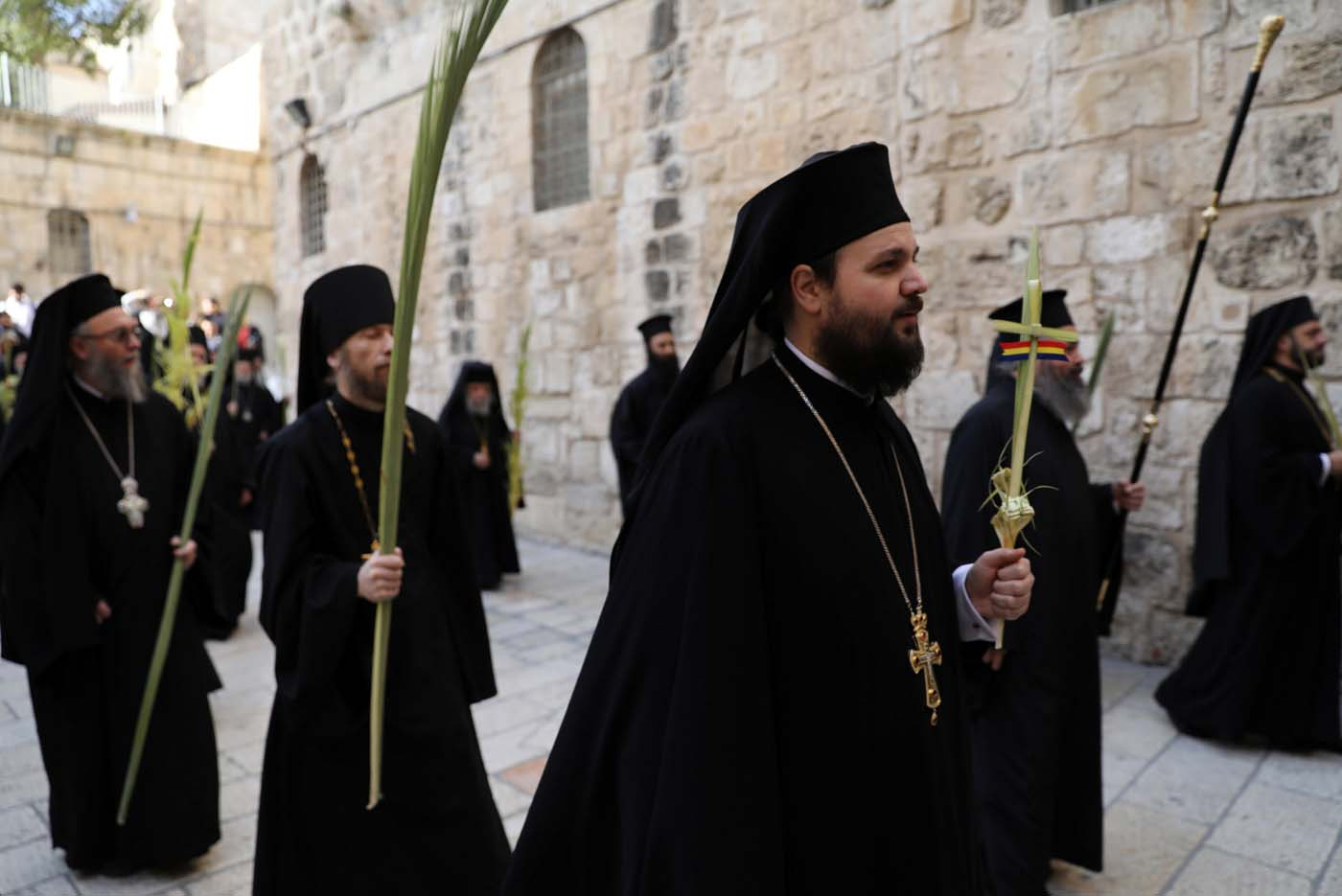 Members of the Orthodox Christian clergy take part in a Palm Sunday ceremony near the Church of the Holy Sepulchre in Jerusalem's Old City April 9, 2017. REUTERS/Ammar Awad
