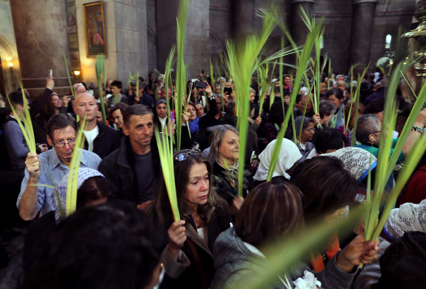 Christian worshippers take part in a Palm Sunday ceremony in the Church of the Holy Sepulchre in Jerusalem's Old City April 9, 2017. REUTERS/Ammar Awad
