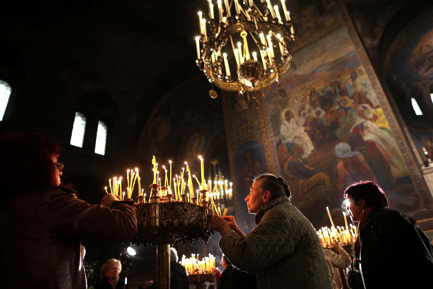 Worshippers light candles during the Palm Sunday service in the Alexander Nevsky Cathedral in Sofia, Bulgaria April 9, 2017. REUTERS/Stoyan Nenov