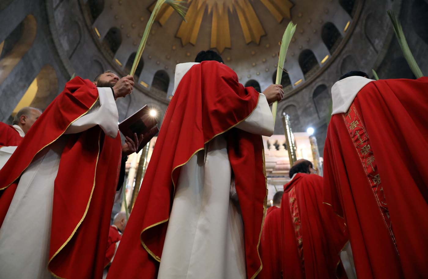 Members of the Catholic Christian clergy take part in a Palm Sunday ceremony in the Church of the Holy Sepulchre in Jerusalem's Old City April 9, 2017. REUTERS/Ammar Awad