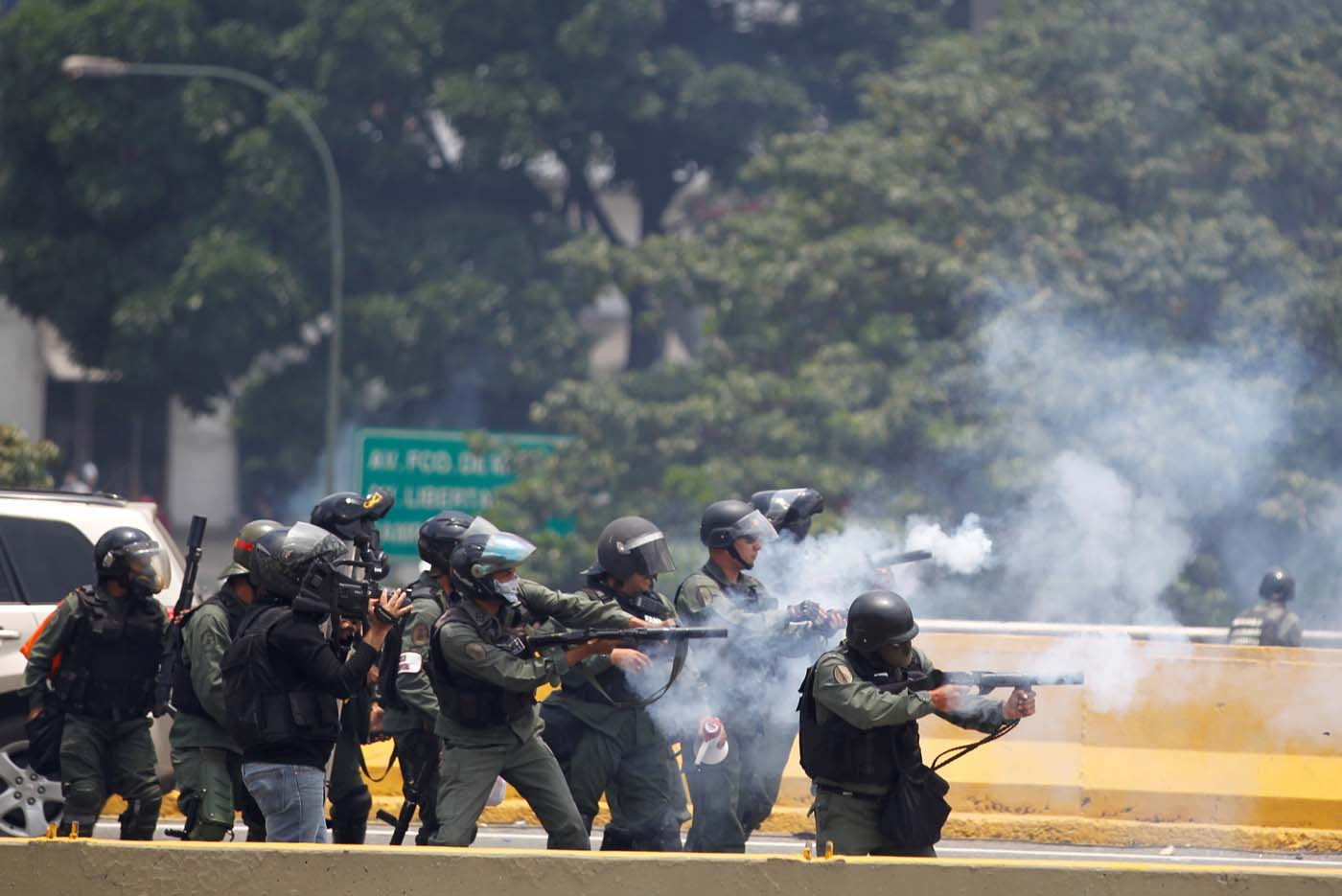 Riot police fire tear gas as demonstrators rally against Venezuela's President Nicolas Maduro's government in Caracas, Venezuela April 10, 2017. REUTERS/Christian Veron