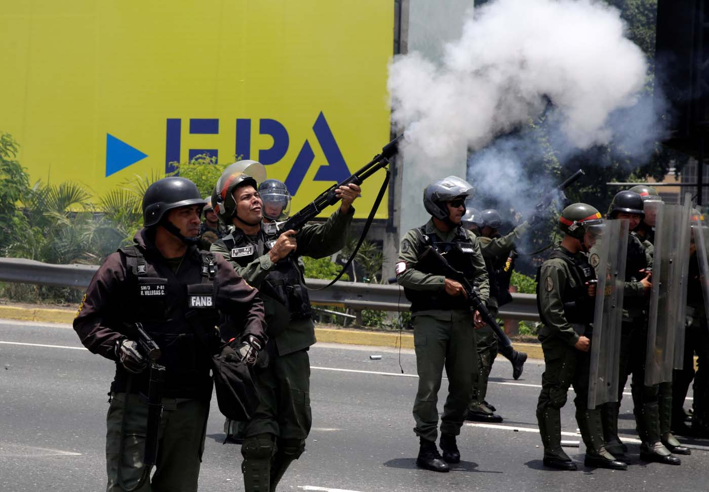 Riot police fire tear gas as demonstrators rally against Venezuela's President Nicolas Maduro's government in Caracas, Venezuela April 10, 2017. REUTERS/Carlos Garcia Rawlins