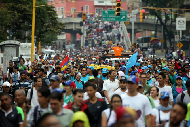 Demonstrators rally against Venezuela's President Nicolas Maduro in Caracas, Venezuela, April 13, 2017. REUTERS/Carlos Garcia Rawlins
