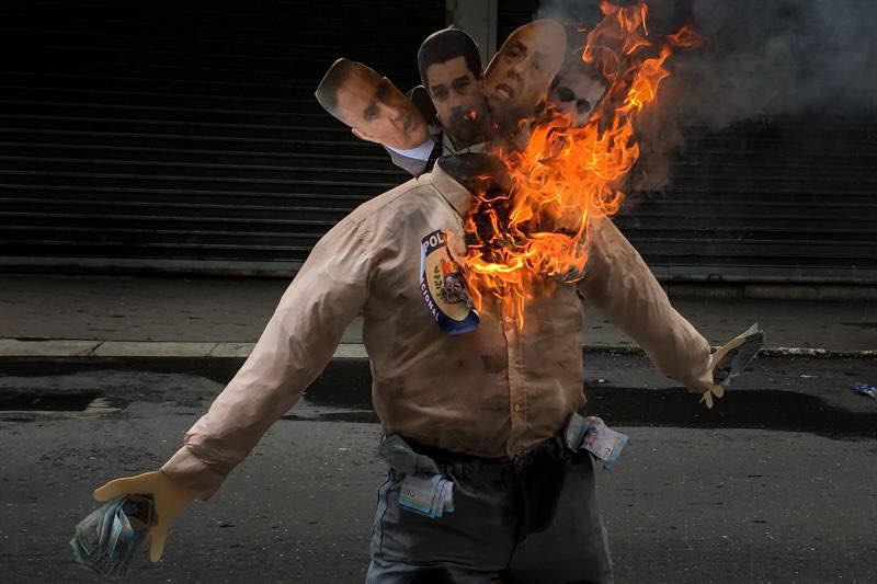 En La Candelaria quemaron la imagen de varios oficialistas. Foto: Miguel Gutiérrez