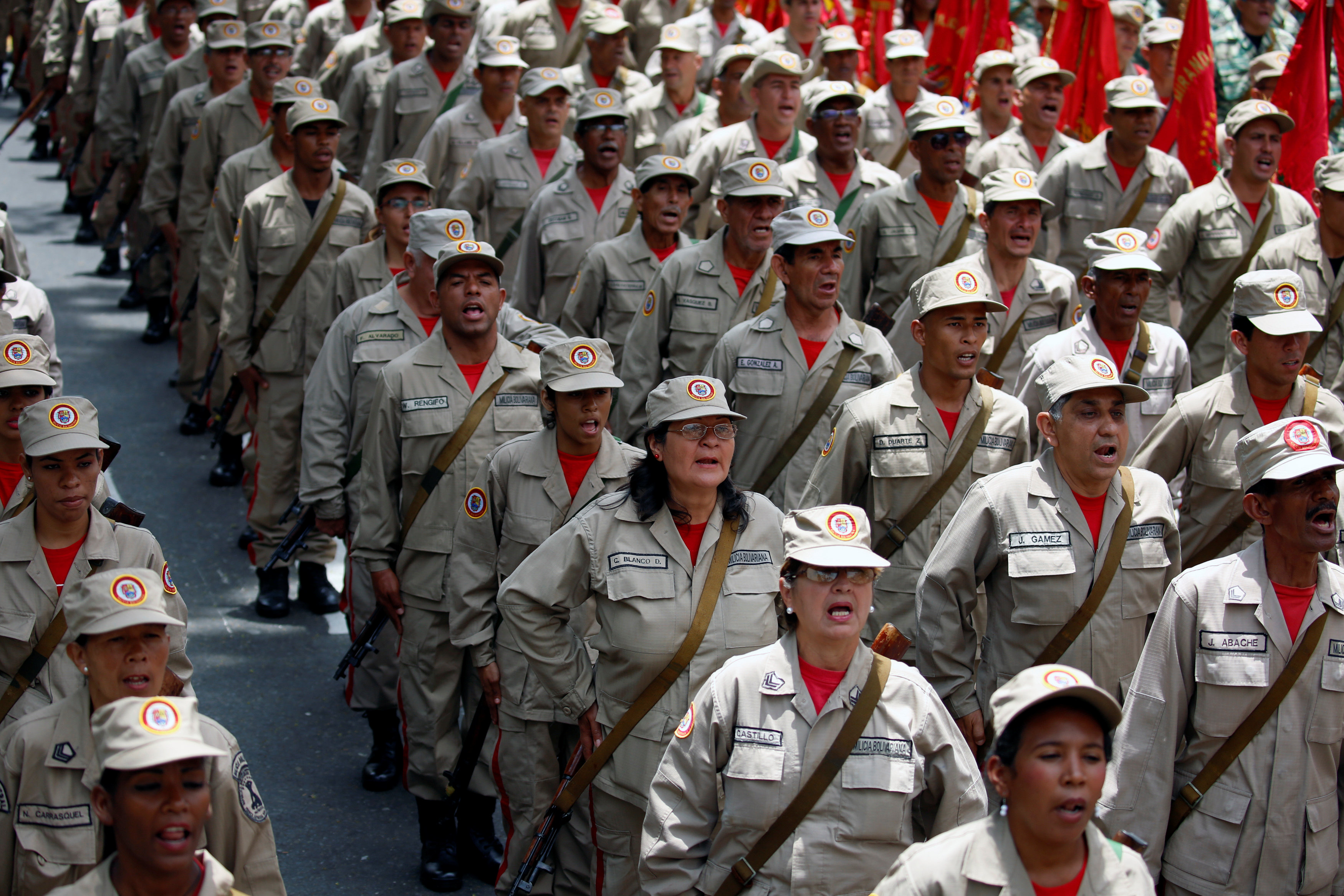 Militia members stand at attention during a ceremony with Venezuela's President Nicolas Maduro at Miraflores Palace in Caracas, Venezuela April 17, 2017. REUTERS/Marco Bello