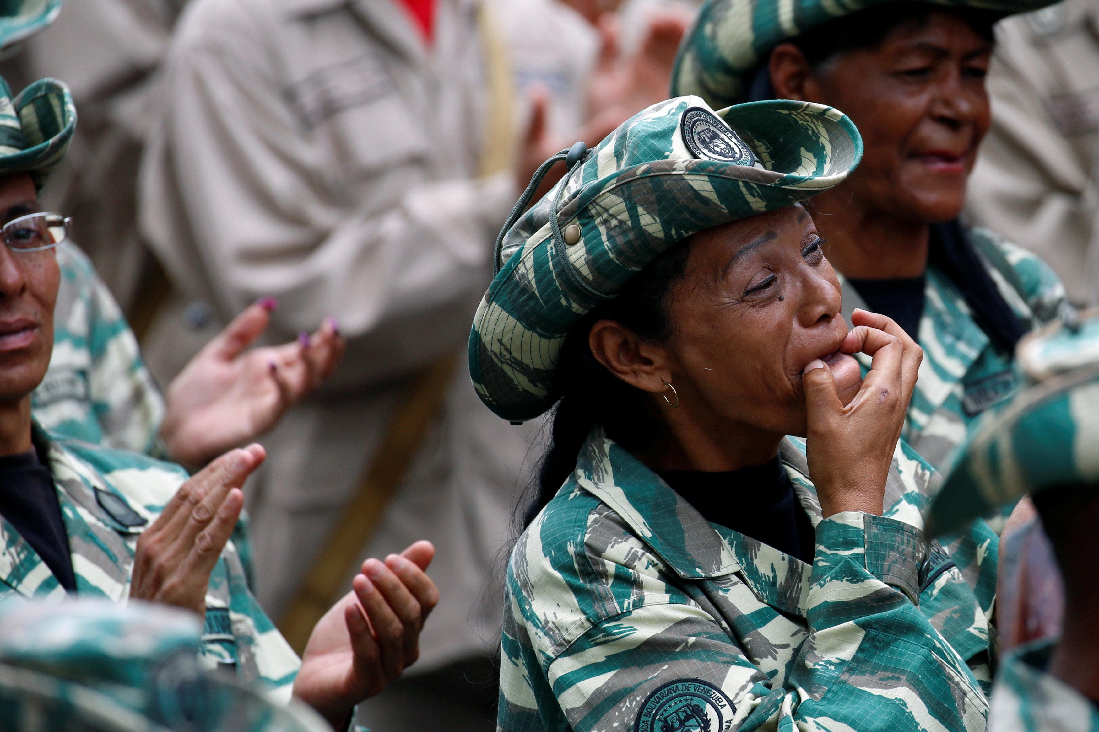 A militia member whistles during a ceremony with Venezuela's President Nicolas Maduro at Miraflores Palace in Caracas, Venezuela April 17, 2017. REUTERS/Marco Bello