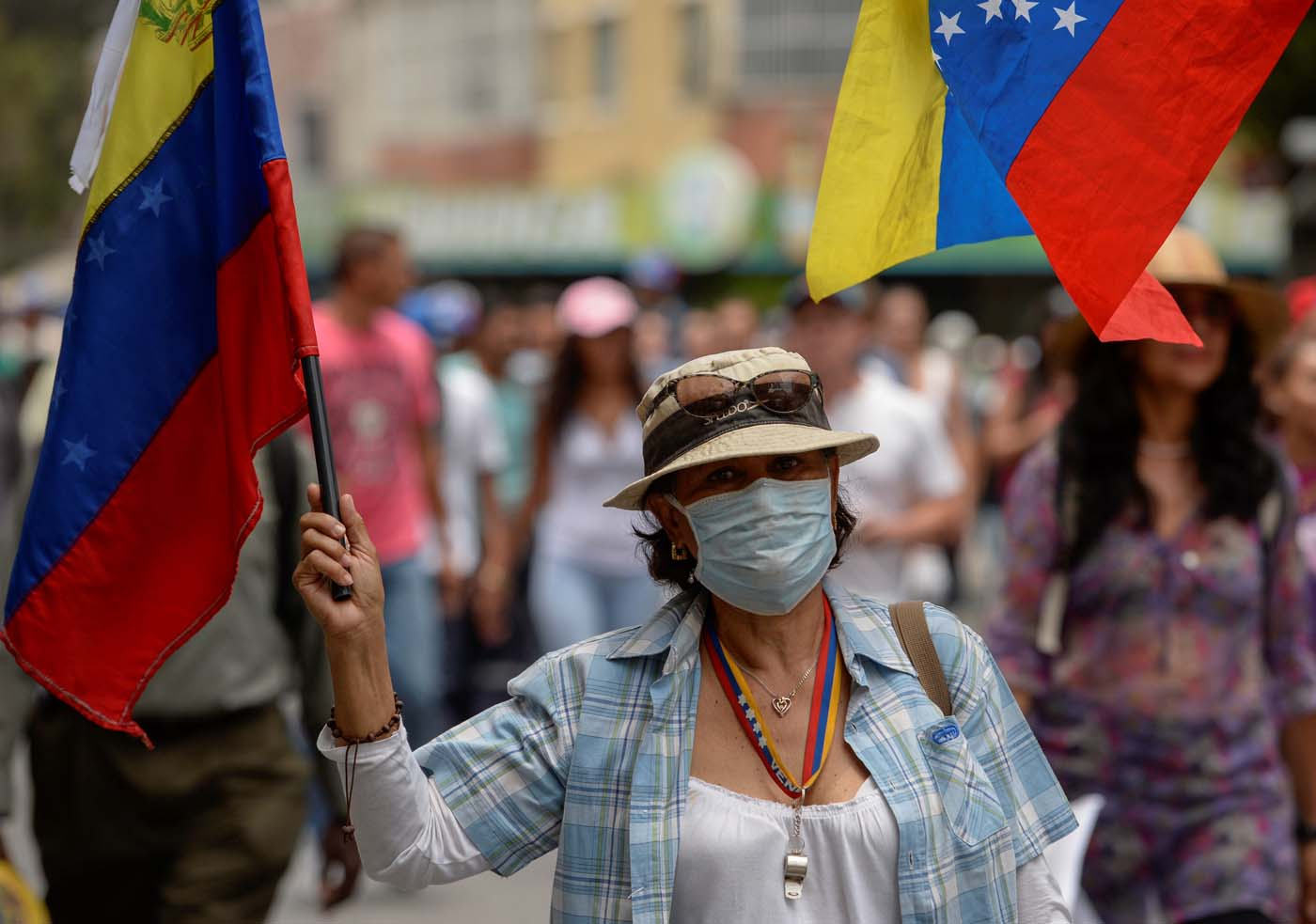 A woman demonstrates during a march against Venezuelan President Nicolas Maduro, in Caracas on April 20, 2017. Venezuelan riot police fired tear gas Thursday at groups of protesters seeking to oust President Nicolas Maduro, who have vowed new mass marches after a day of deadly unrest. Police in western Caracas broke up scores of opposition protesters trying to join a larger march, though there was no immediate repeat of Wednesday's violent clashes, which left three people dead. / AFP PHOTO / Federico PARRA