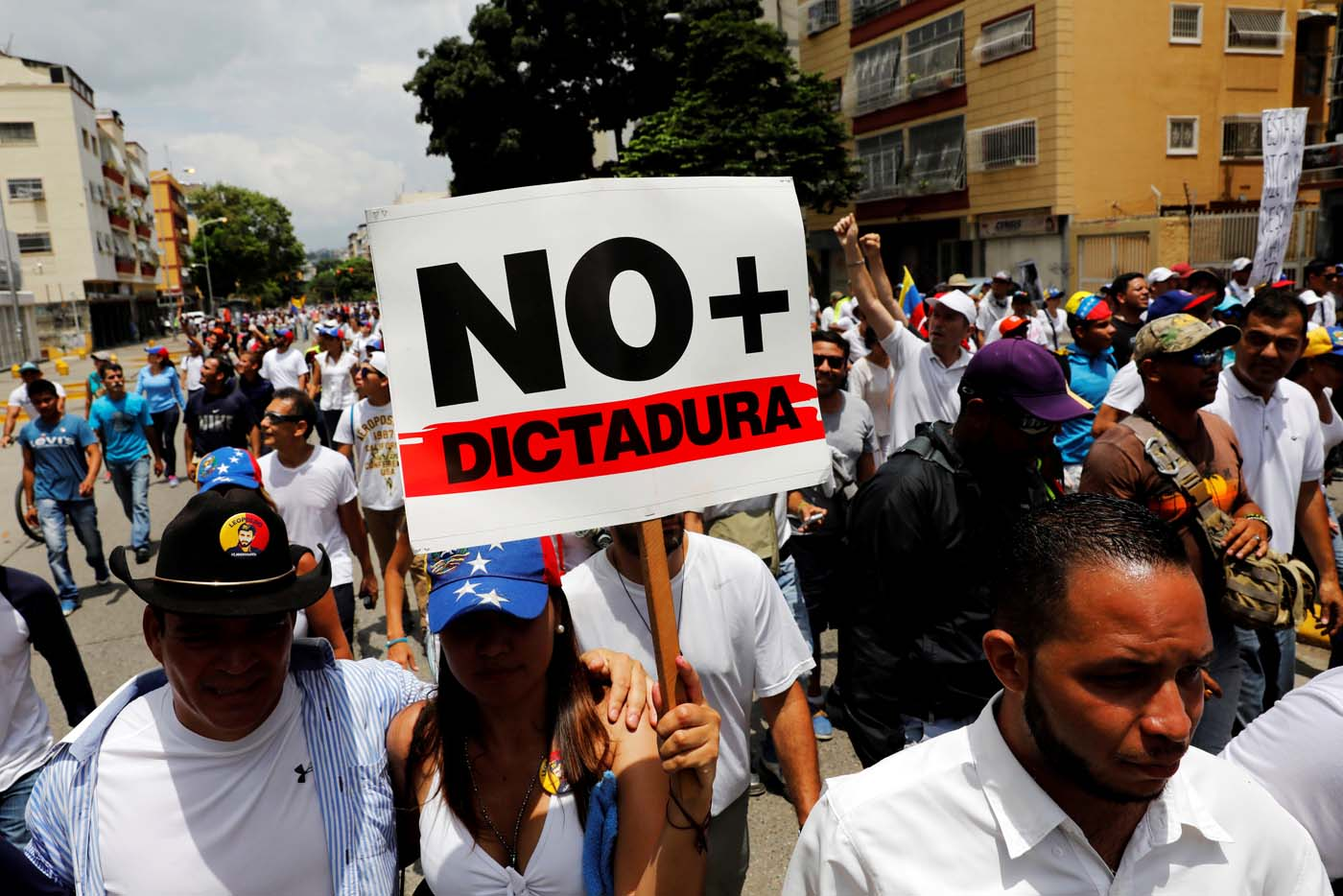 "Demonstrators take part in a rally to honor the victims of violence during the protests and against Venezuela's President Nicolas Maduro's government in Caracas, Venezuela, April 22, 2017. Placard reads ""No more dictatorship"" REUTERS/Carlos Garcia Rawlins"