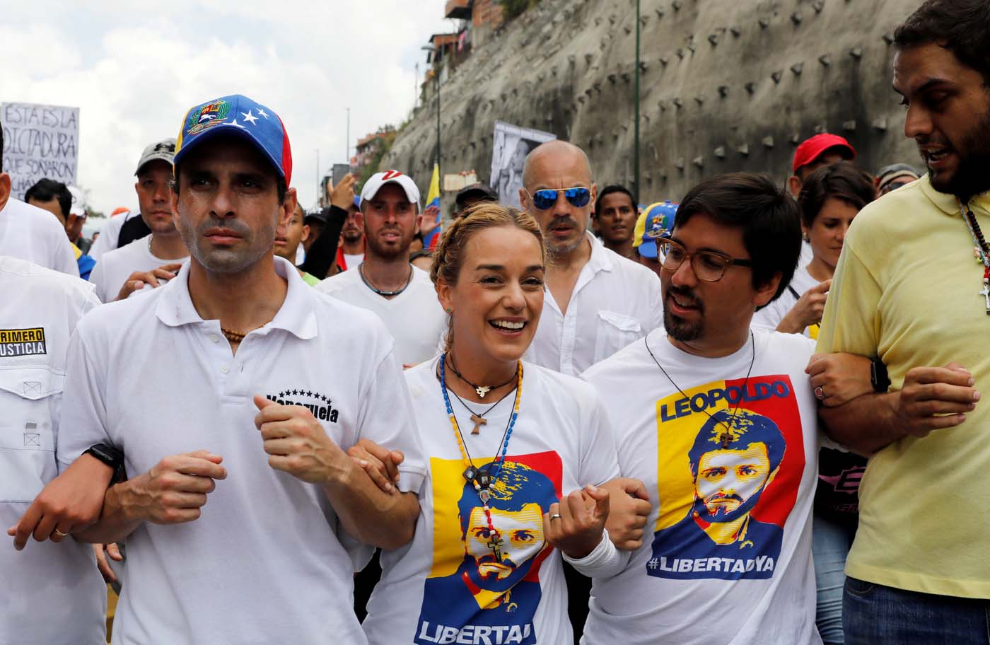 (L to R), Venezuelan opposition leader and Governor of Miranda state Henrique Capriles, Lilian Tintori, wife of jailed opposition leader Leopoldo Lopez and Congressman Freddy Guevara take part in a rally to honour victims of violence during a protest against Venezuela's President Nicolas Maduro's government in Caracas, Venezuela, April 22, 2017. REUTERS/Carlos Garcia Rawlins