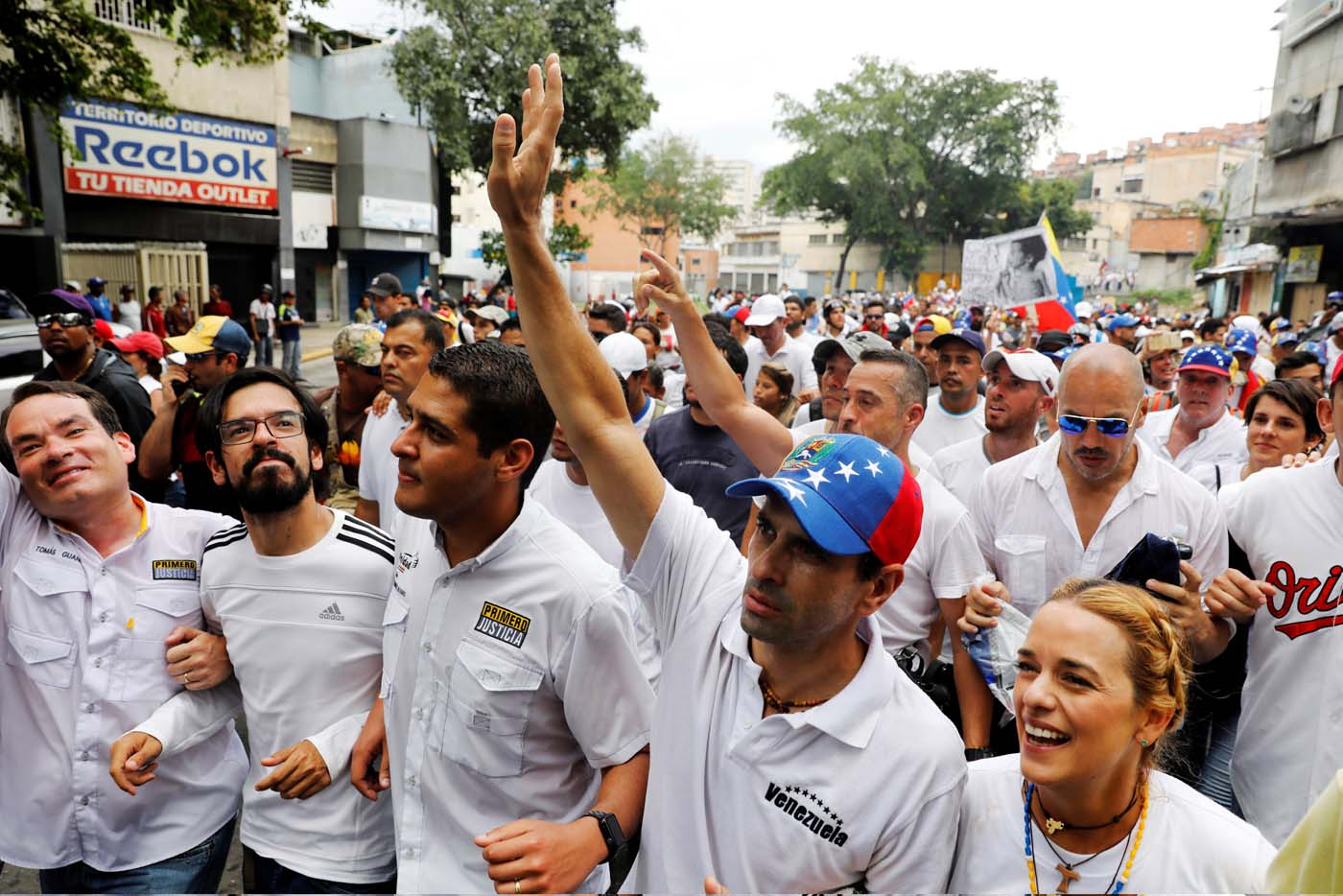 Lawmakers walk together with Venezuelan opposition leader and Governor of Miranda state Henrique Capriles (2nd R) and Lilian Tintori, wife of jailed opposition leader Leopoldo Lopez, as they take part in a rally to honour victims of violence during a protest against Venezuela's President Nicolas Maduro's government in Caracas, Venezuela, April 22, 2017. REUTERS/Carlos Garcia Rawlins