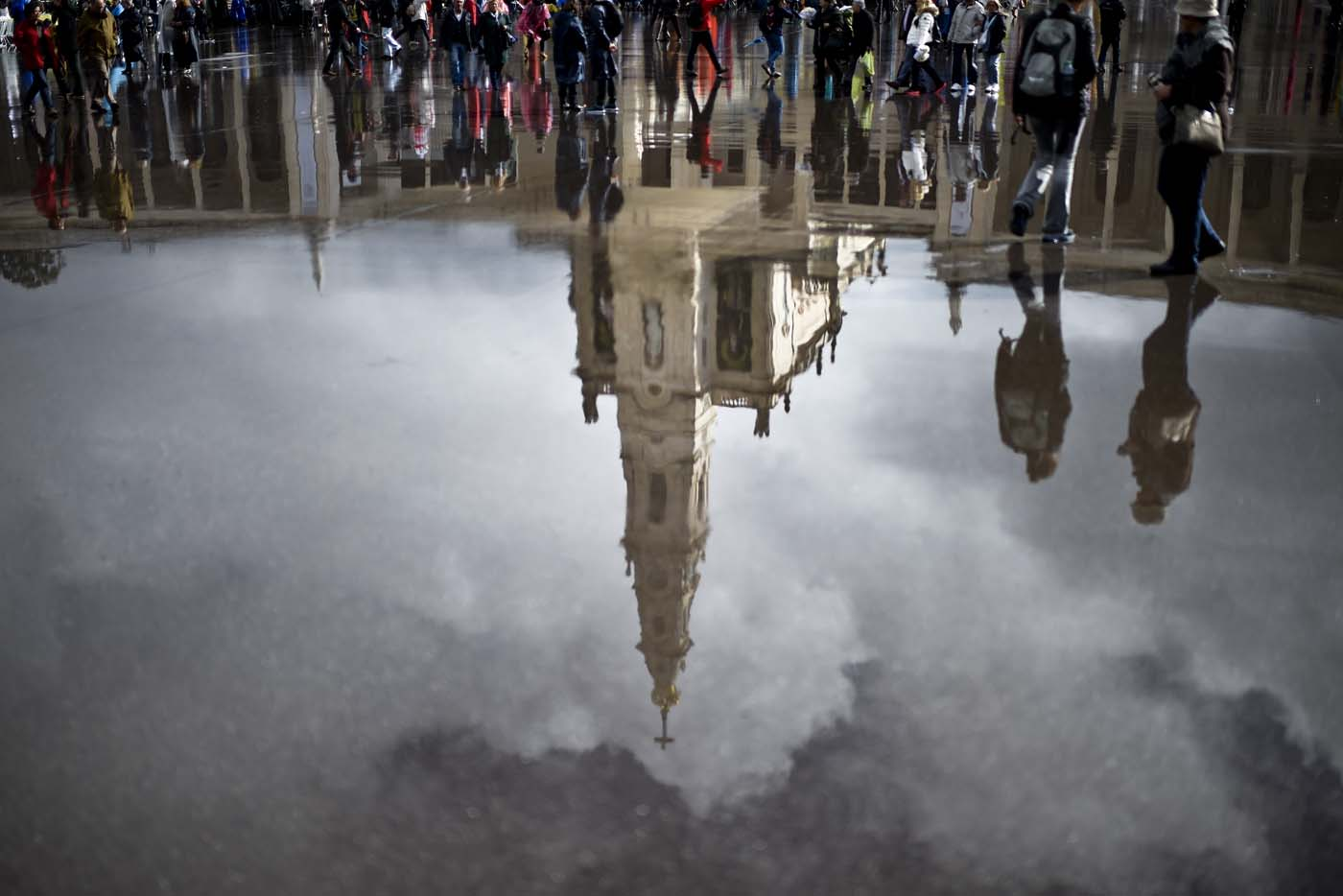 """Nossa Senhora do Rosario de Fatima"" Basilica is reflected on the wet pavement in Fatima, central Portugal, on May 12, 2017. Two of the three child shepherds who reported apparitions of the Virgin Mary in Fatima, Portugal, one century ago, will be declared saints on May 13, 2017 by Pope Francis. The canonisation of Jacinta and Francisco Marto will take place during the Argentinian pontiff's visit to a Catholic shrine visited by millions of pilgrims every year. / AFP PHOTO / PATRICIA DE MELO MOREIRA"